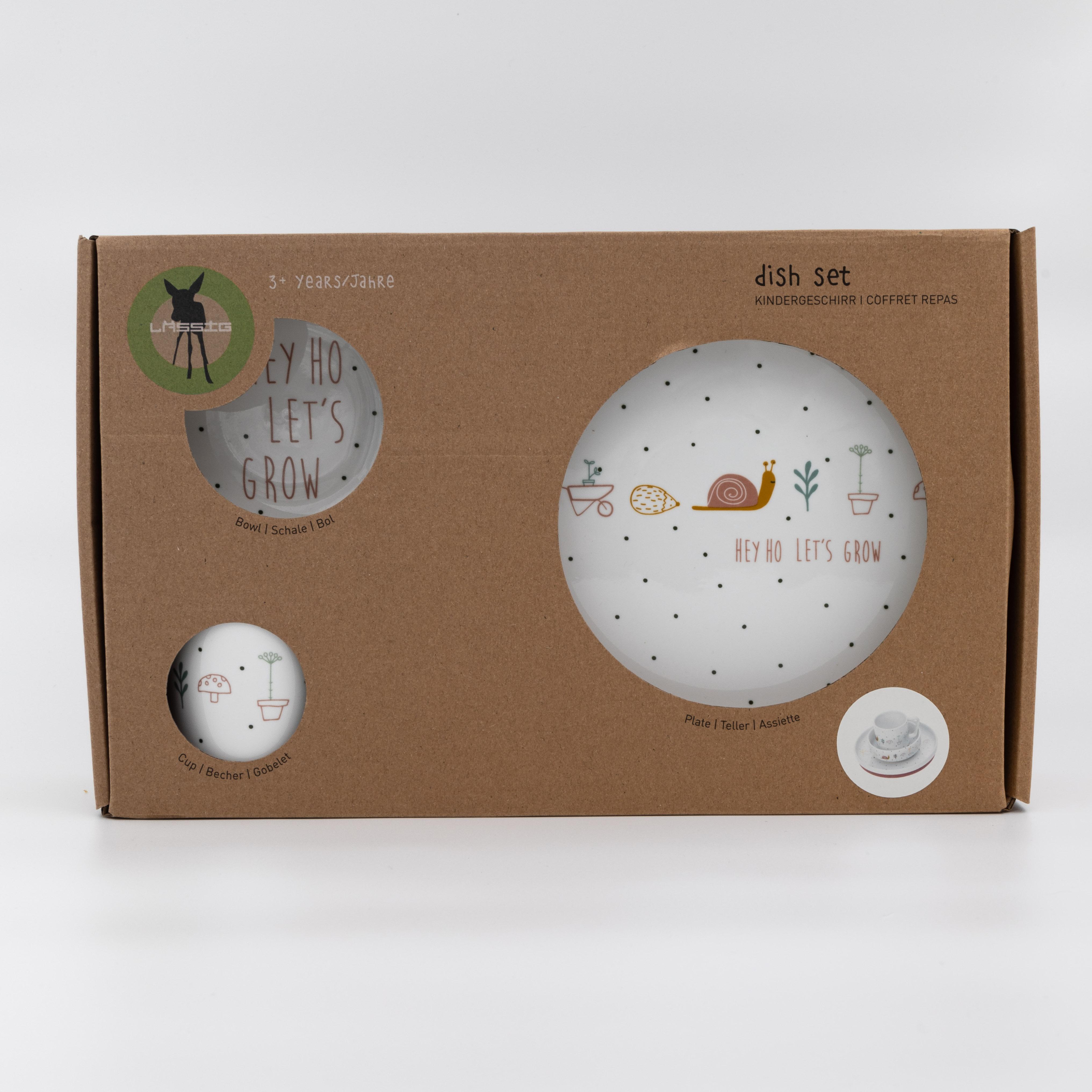 Weisses Kindergeschirr mit Gartenmotiven in Kartonverpackung.