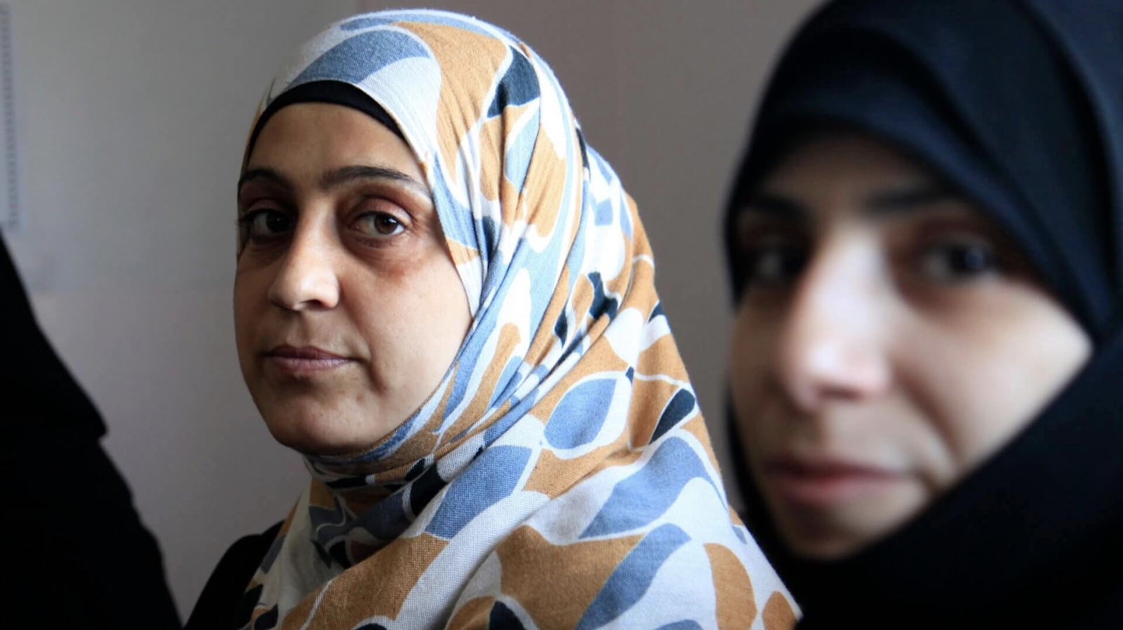 Muslin women wearing hijab waiting for their asylum green card interview