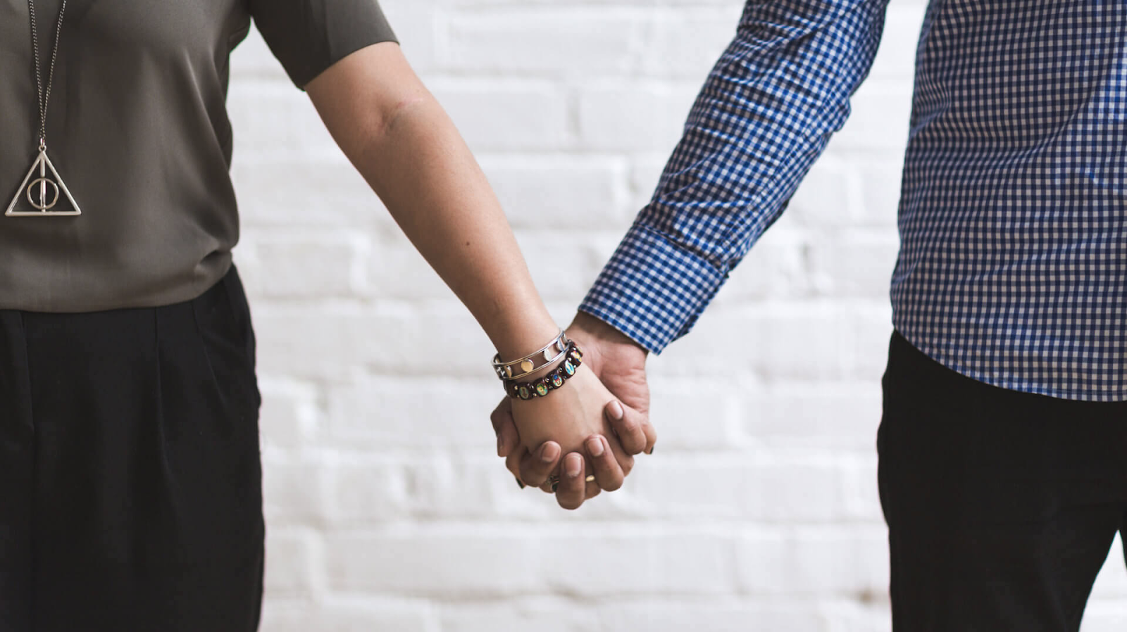 Married couple holding hands before marriage green card interview