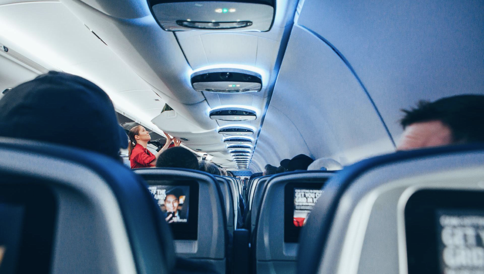 Passengers and seats inside of the international flight airplane