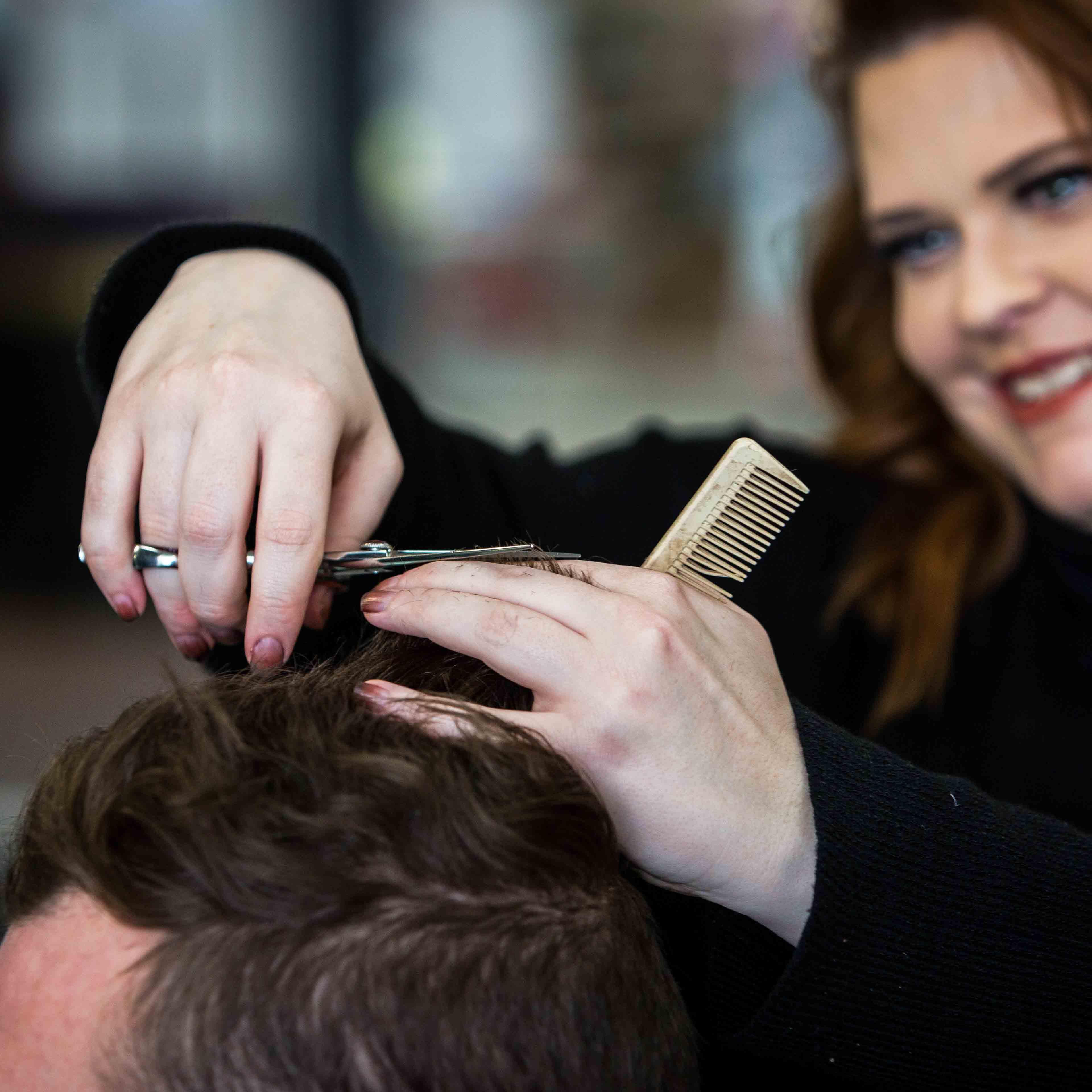 Kelleigh cutting mens hair at Sharda Hair Salon
