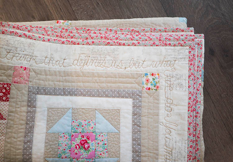 folded-quilt-with-scripted-quilting