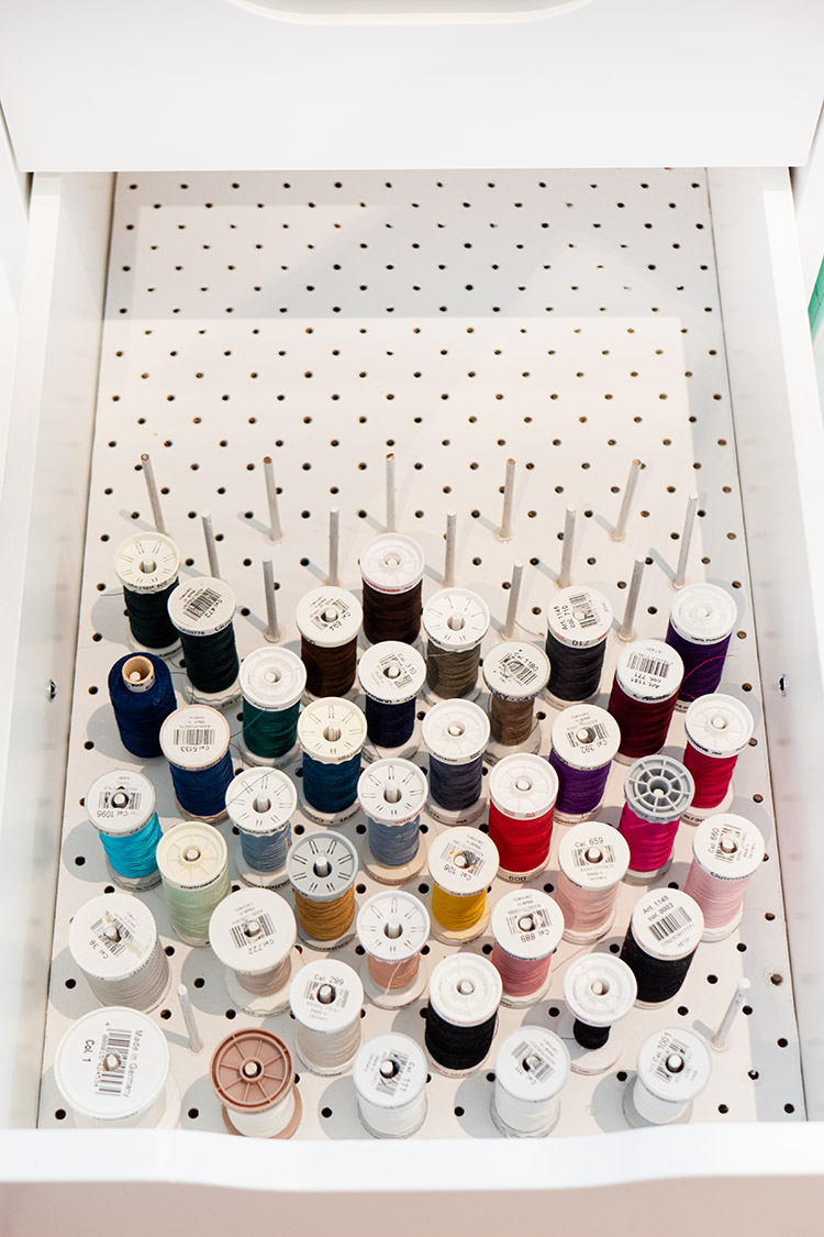 Clever Thread Storage Solution Ikea Hack - large spools on pegboard