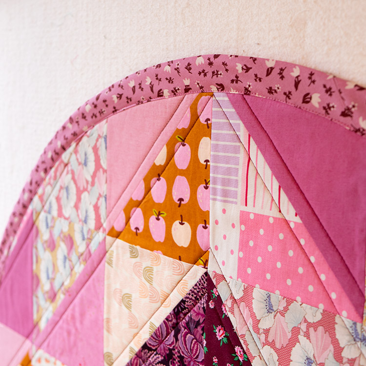 How to Make a Circular Quilted Playmat - finished binding stitched down