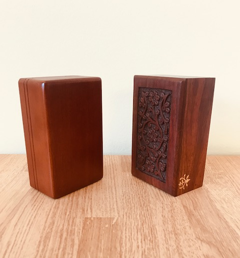 Standard wooden mahogany pet memorial urn included in price of cremation image.