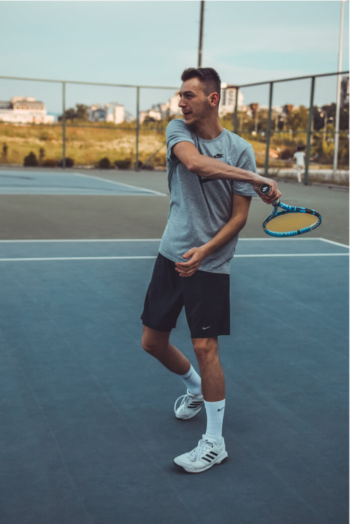 Amateur tennis players hitting a forehand on a tennis court