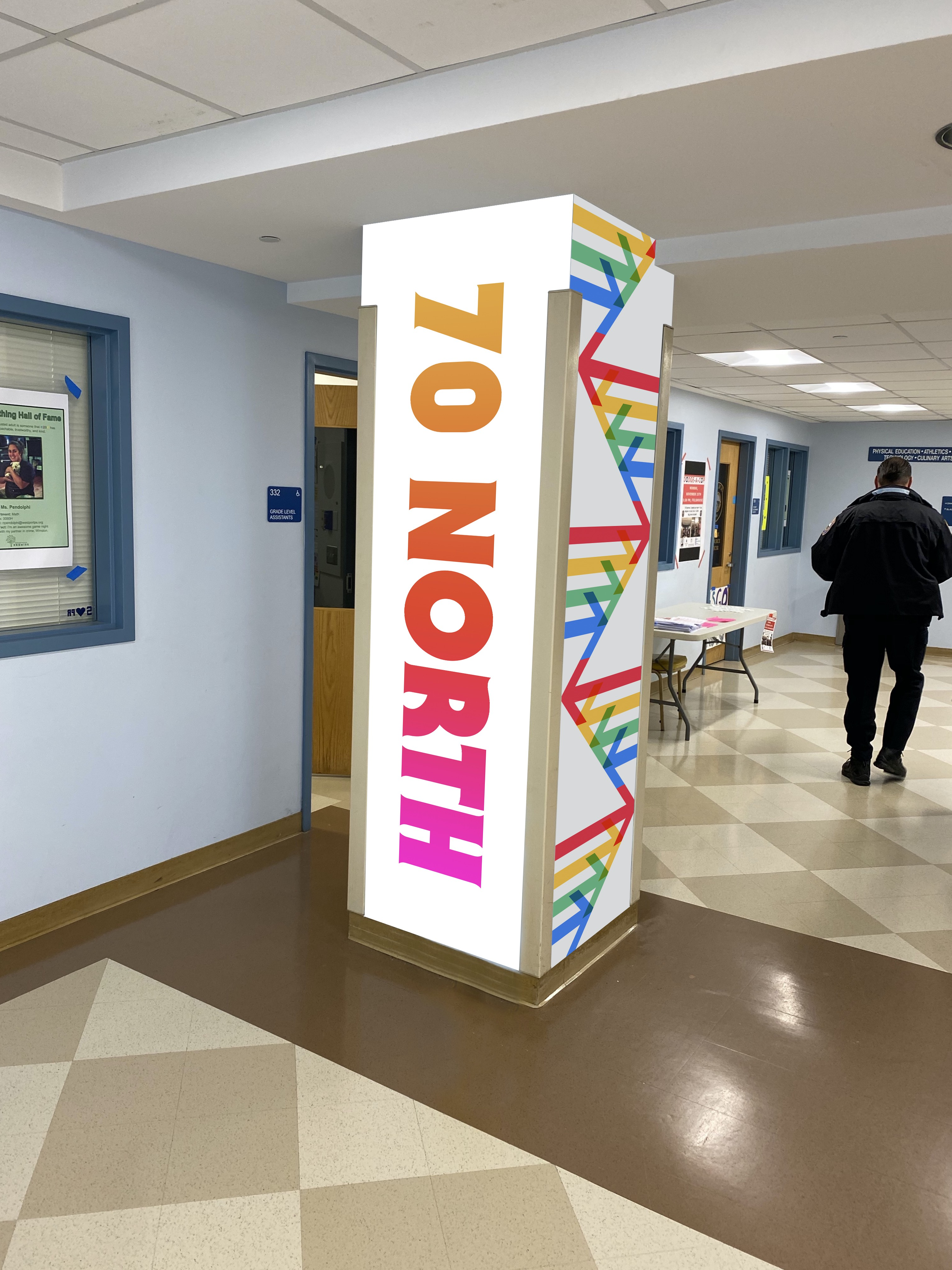 A conceptual column wrap. 70 North and multi-colored branding arrows run down the sides of the column.