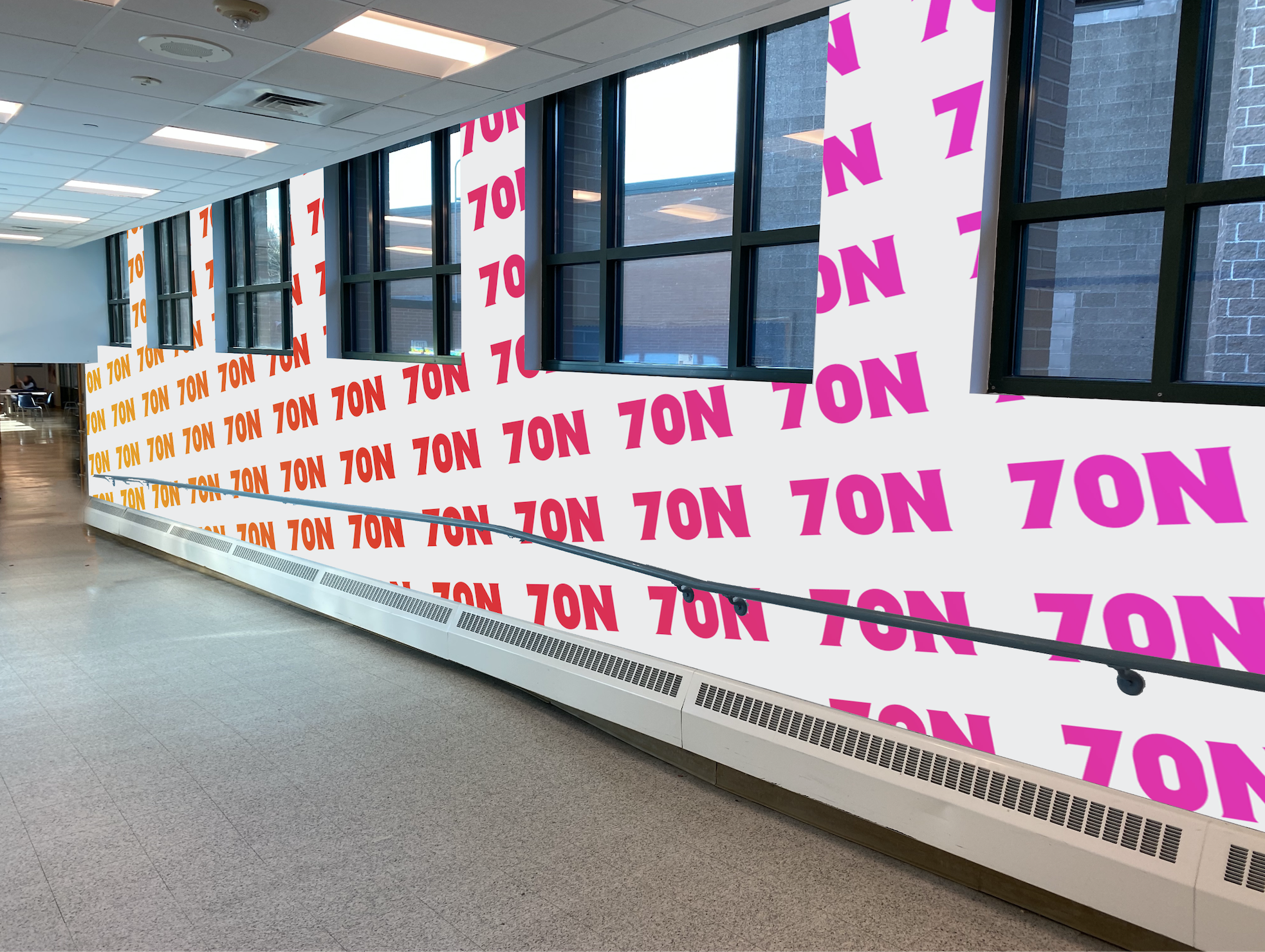A conceptual full-wall wrap. The 70 North logo is tiled down the walls of a long corridor.
