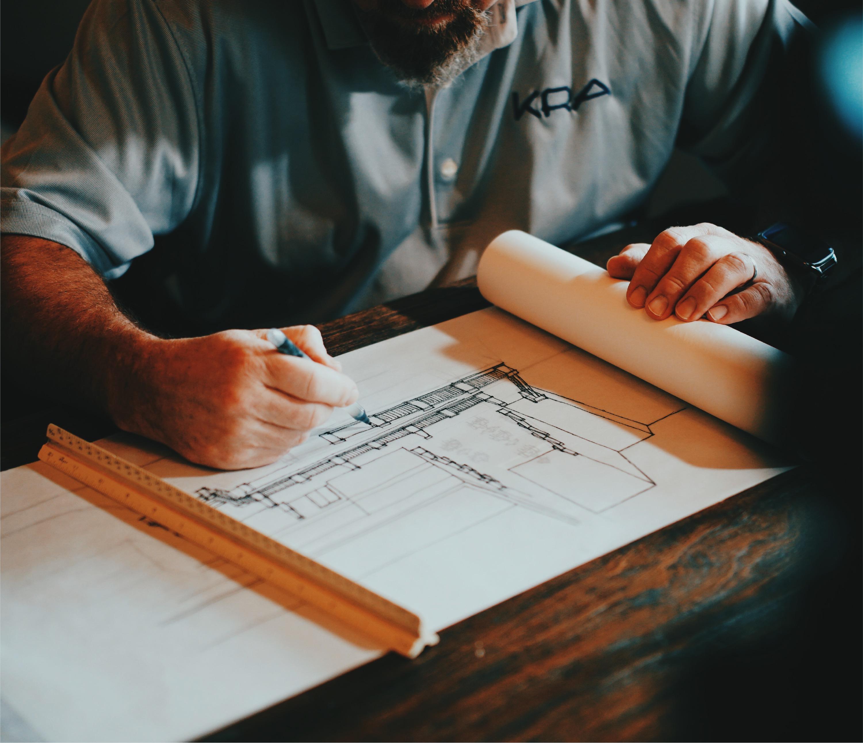 Man Sketching Design Structure