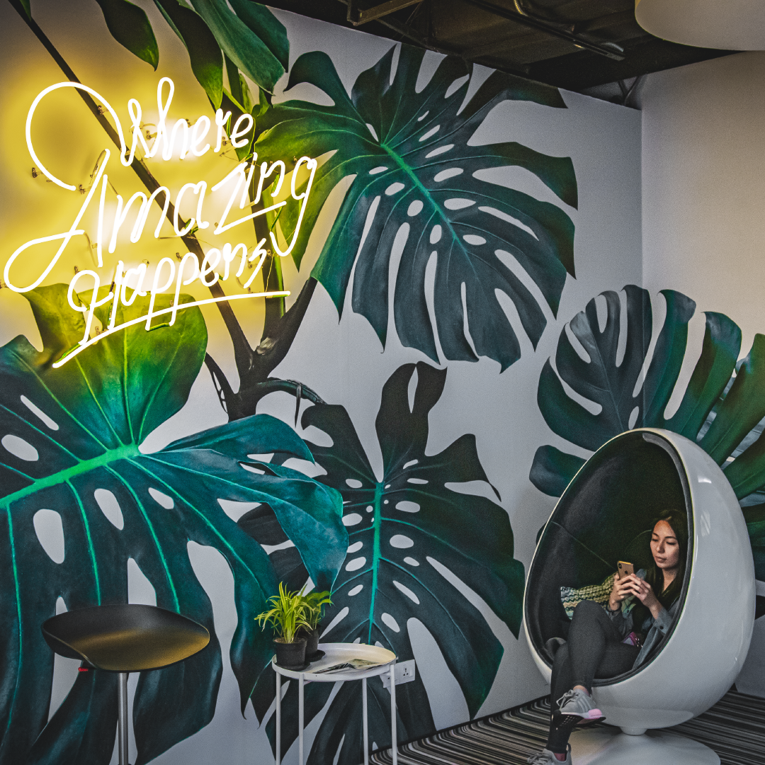 Where Amazing Happens Neon Light bulb banana leaf wallpaper girl in an eggchair