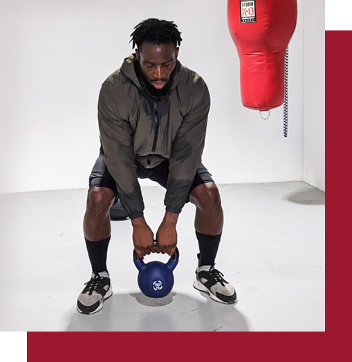 man with kettlebell and punch bag