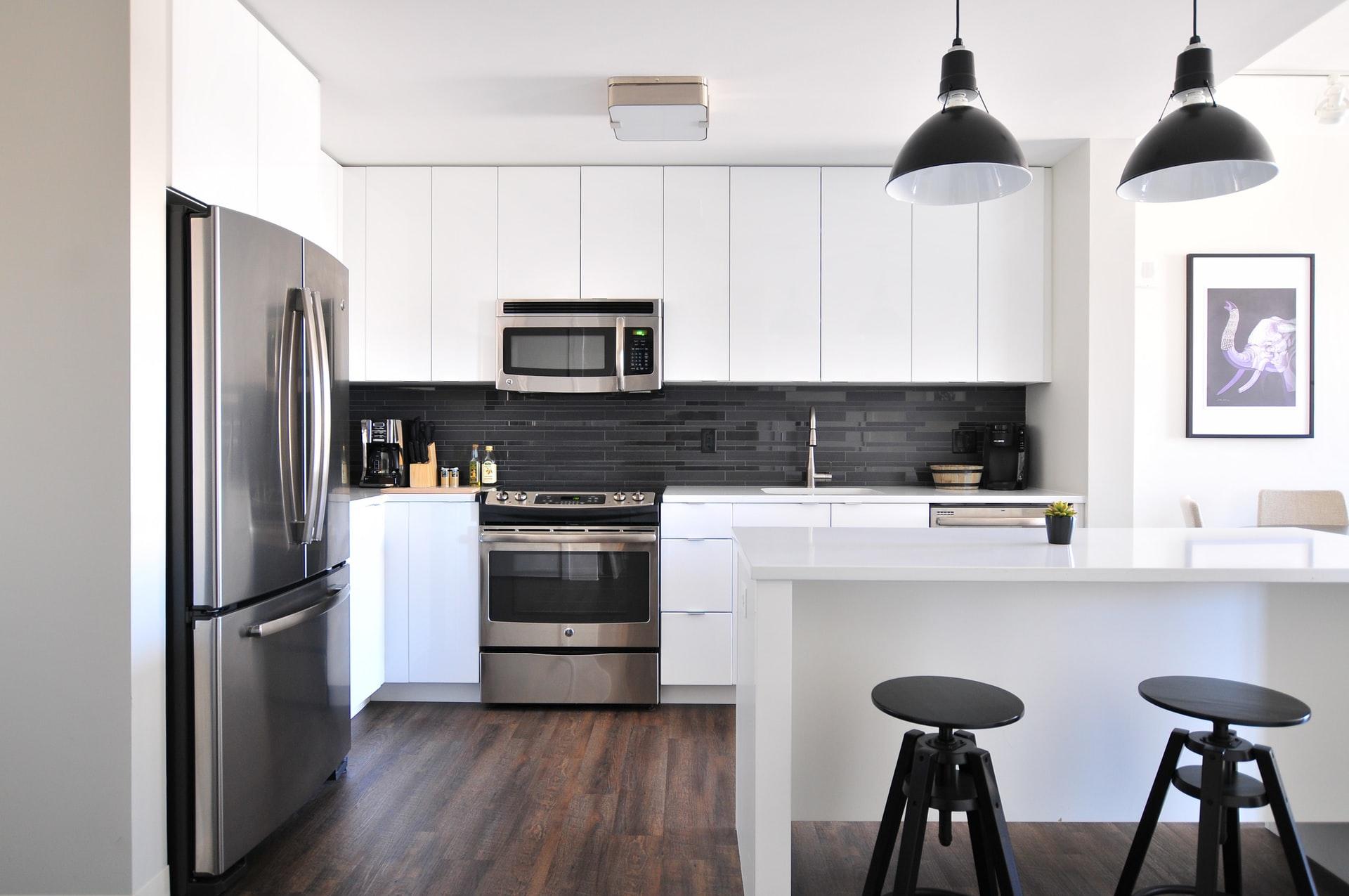 Grey steel refrigerator in a white kitchen