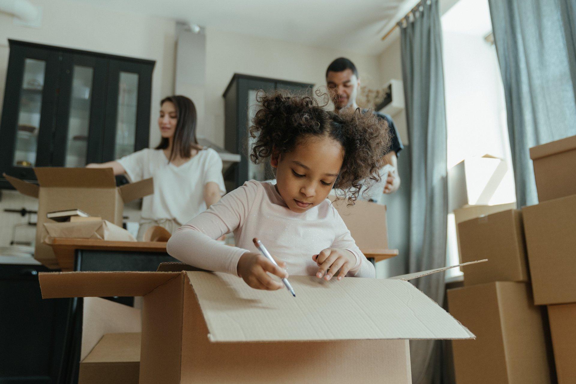 Girl in White Long Sleeve Shirt Writing on White Paper