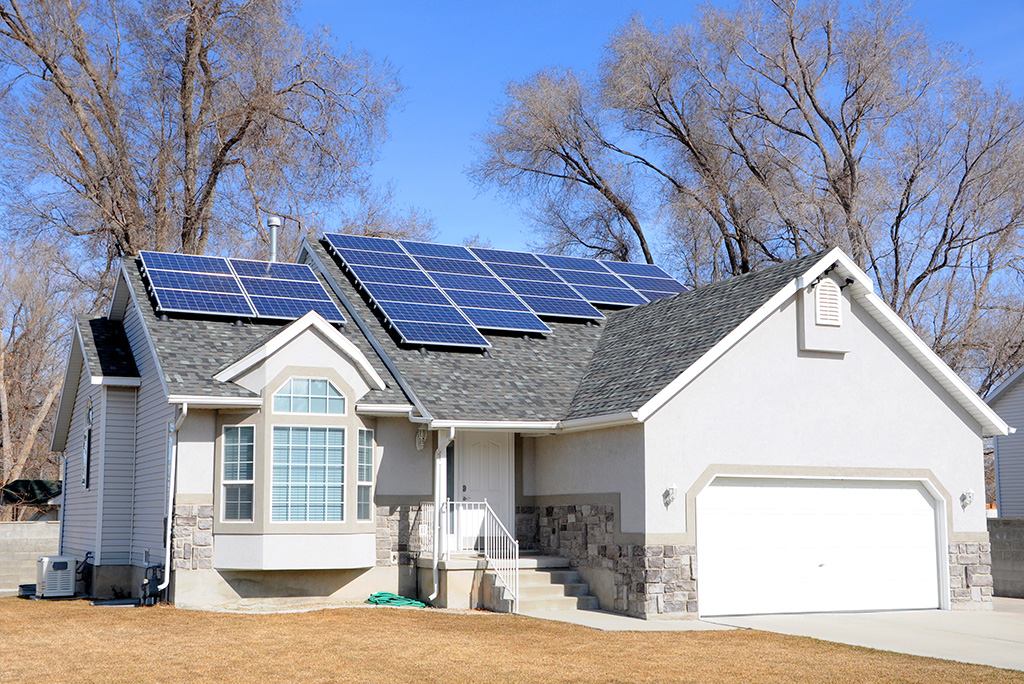 Residential house with solar panels installed on the roof