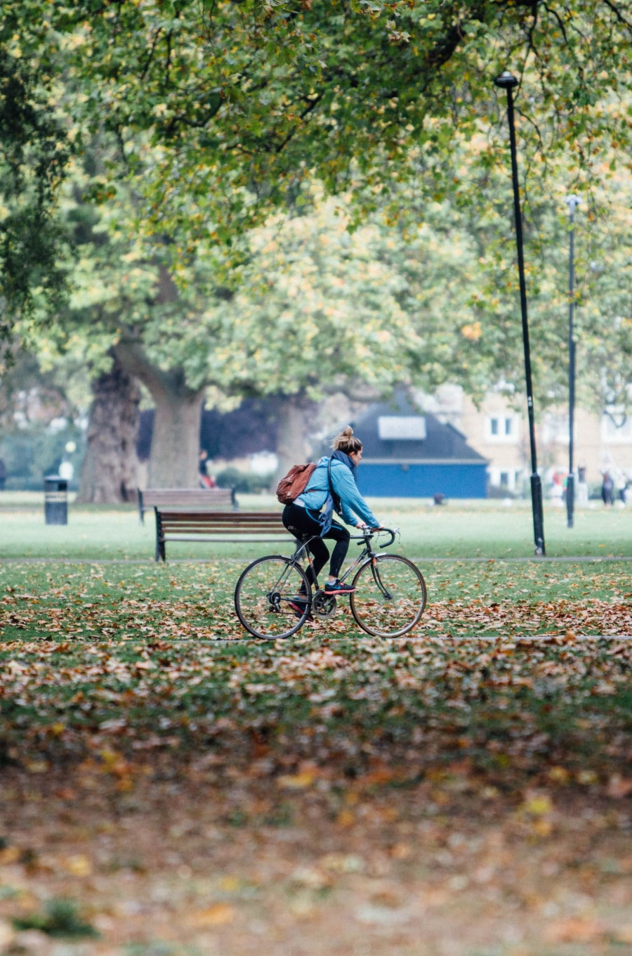 Cyclist riding through London Fields