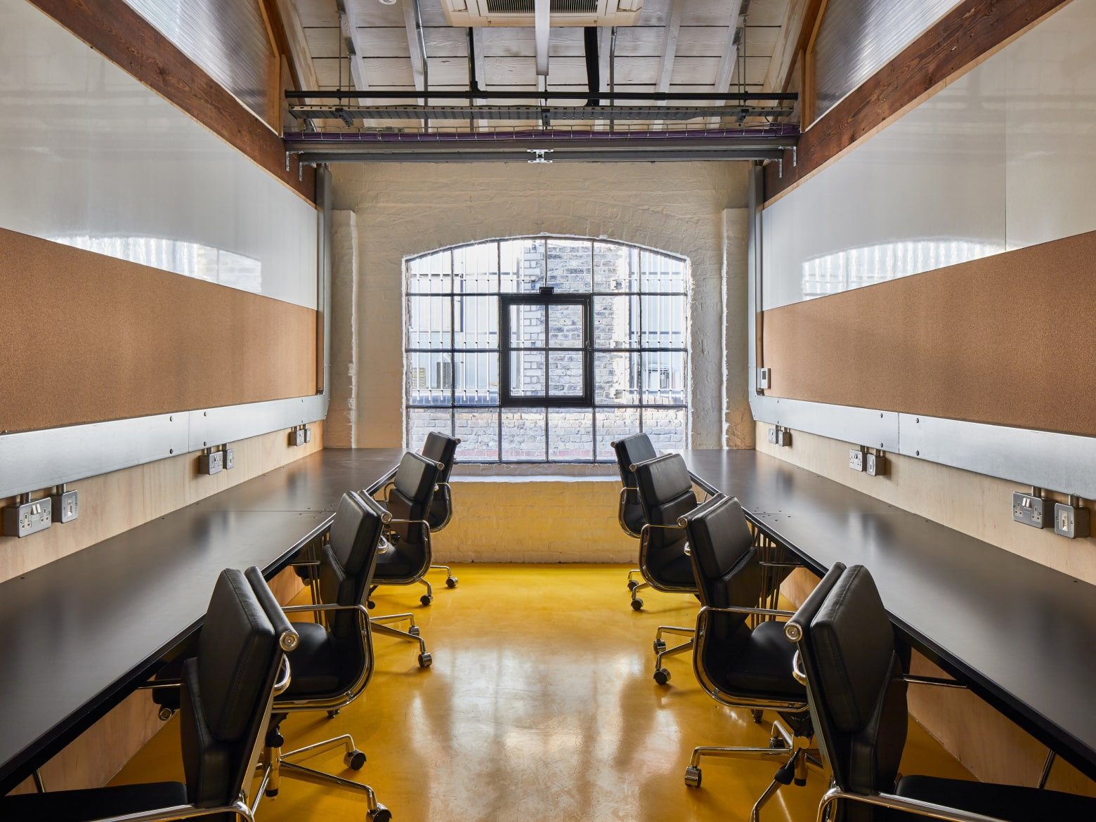 office space with leather chairs and desks