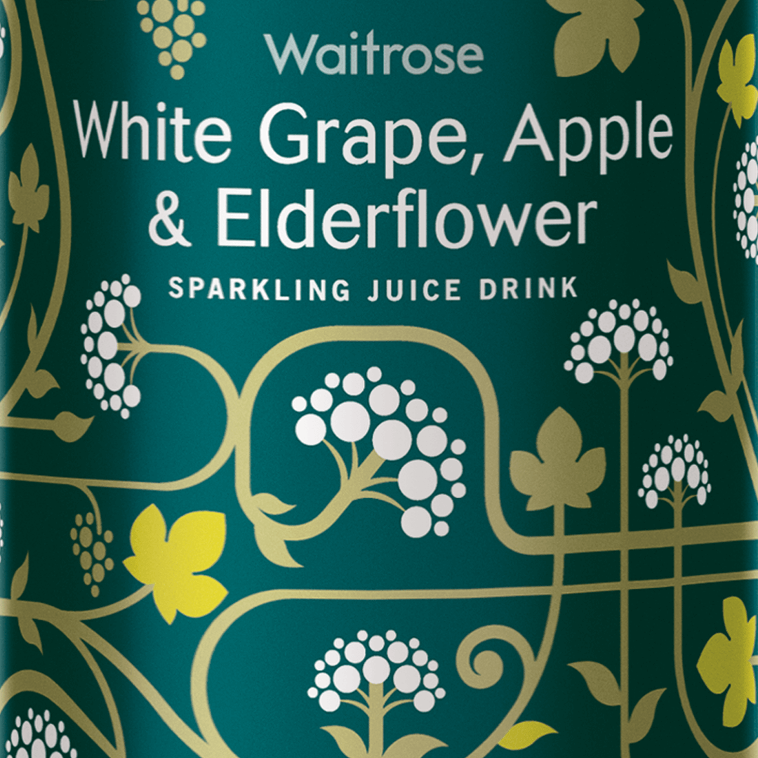 Waitrose Sparkling Juice bottle design by Mutiny Agency White Grape apple and elderflower. Award winning Packaging Design for Waitrose by Mutiny Agency. The label feels premium, stood out on shelves and wouldn't feel out of place at the dinner table. The packaging was recognised by AIGA 365 as one the examples of global design excellence.