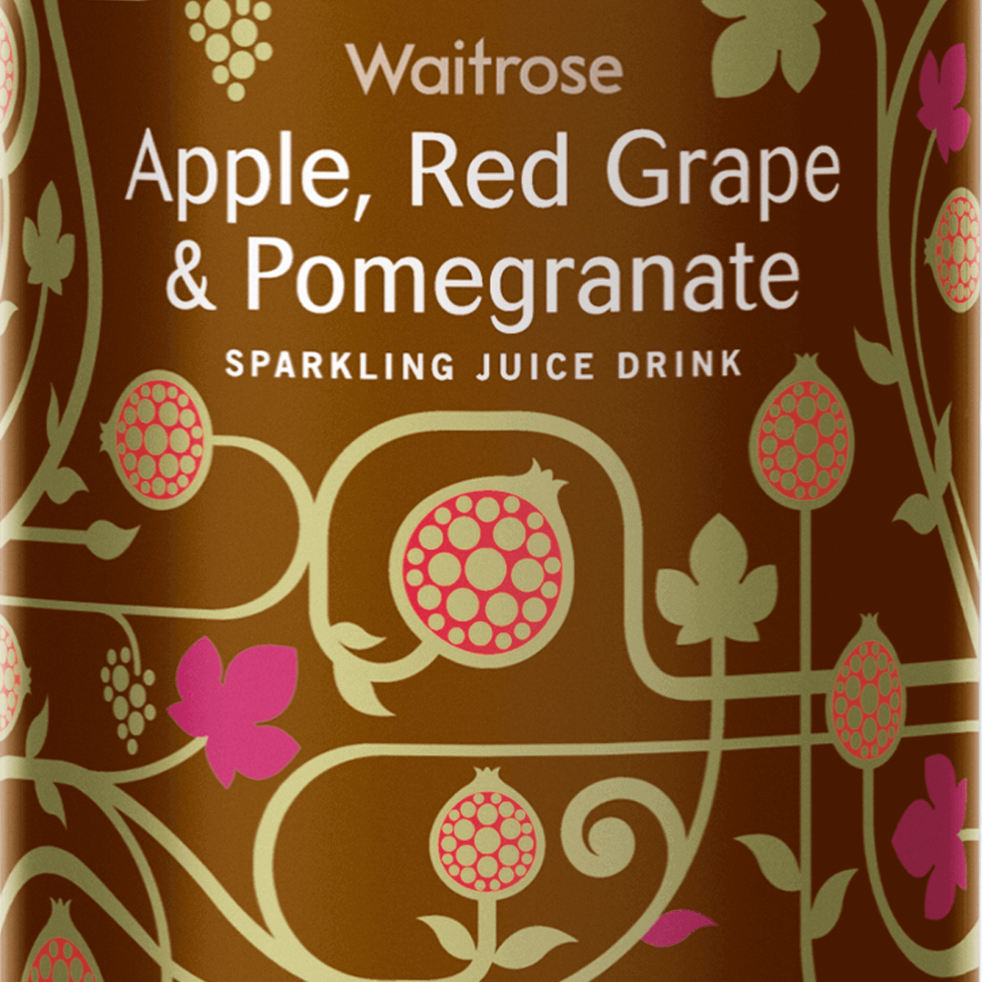 Waitrose Sparkling Juice bottle design by Mutiny Agency Apple Red Grape and Pomegranate.  Award winning Packaging Design for Waitrose by Mutiny Agency. The label feels premium, stood out on shelves and wouldn't feel out of place at the dinner table. The packaging was recognised by AIGA 365 as one the examples of global design excellence. The label feels premium, stood out on shelves and wouldn't feel out of place at the dinner table. The packaging was recognised by AIGA 365 as one the examples of global design excellence.