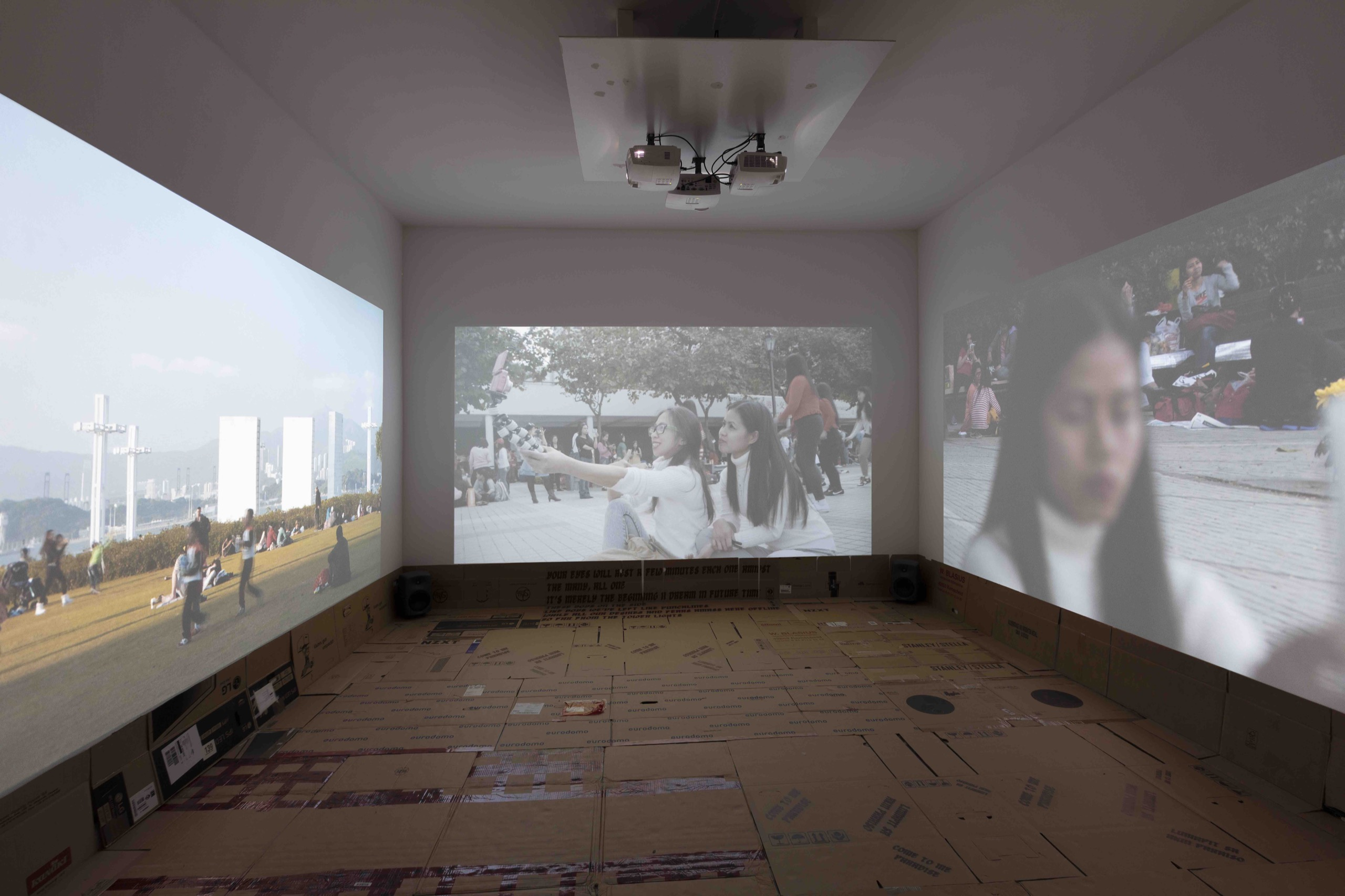 Stephanie Comilang, Lumapit Sa Akin, Paraiso (Come to Me, Paradise), 2016, 3 channel video projection, cardboards,  UV print texts on cardboard 25:46