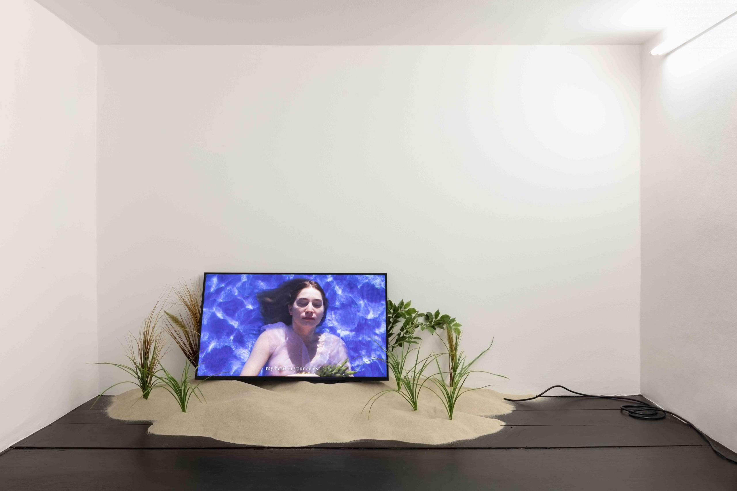 Juan Antonio Olivares, Kokomo Lost, 2016, CNC-milled EPS foam, sand, driftwood, artificial foliage, LED monitor, media player, external speaker, HD video, 7:08