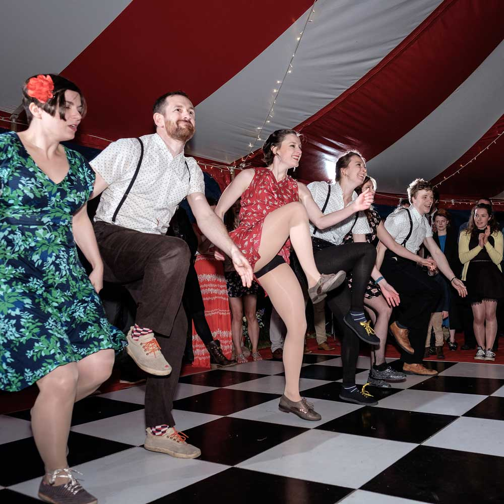 Dancers in a circus tent