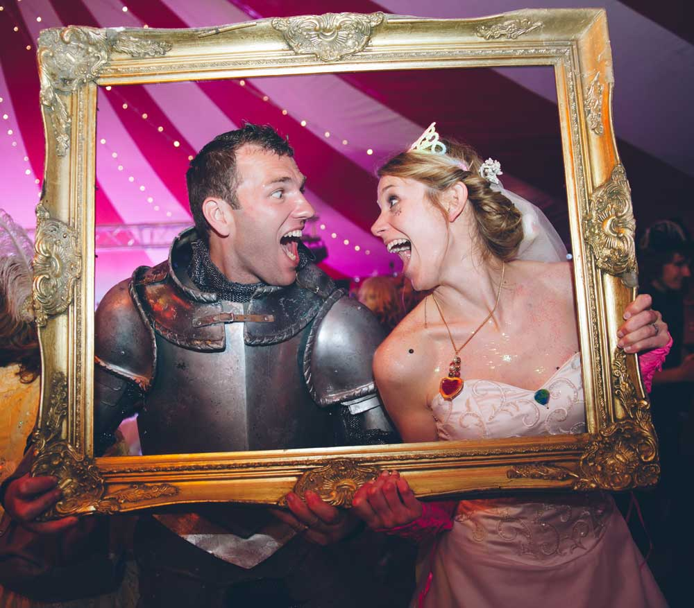 Wedding couple at photobooth with props