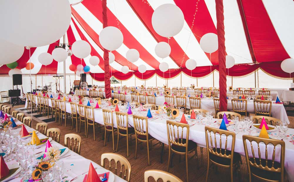 A wedding table within a circus tent