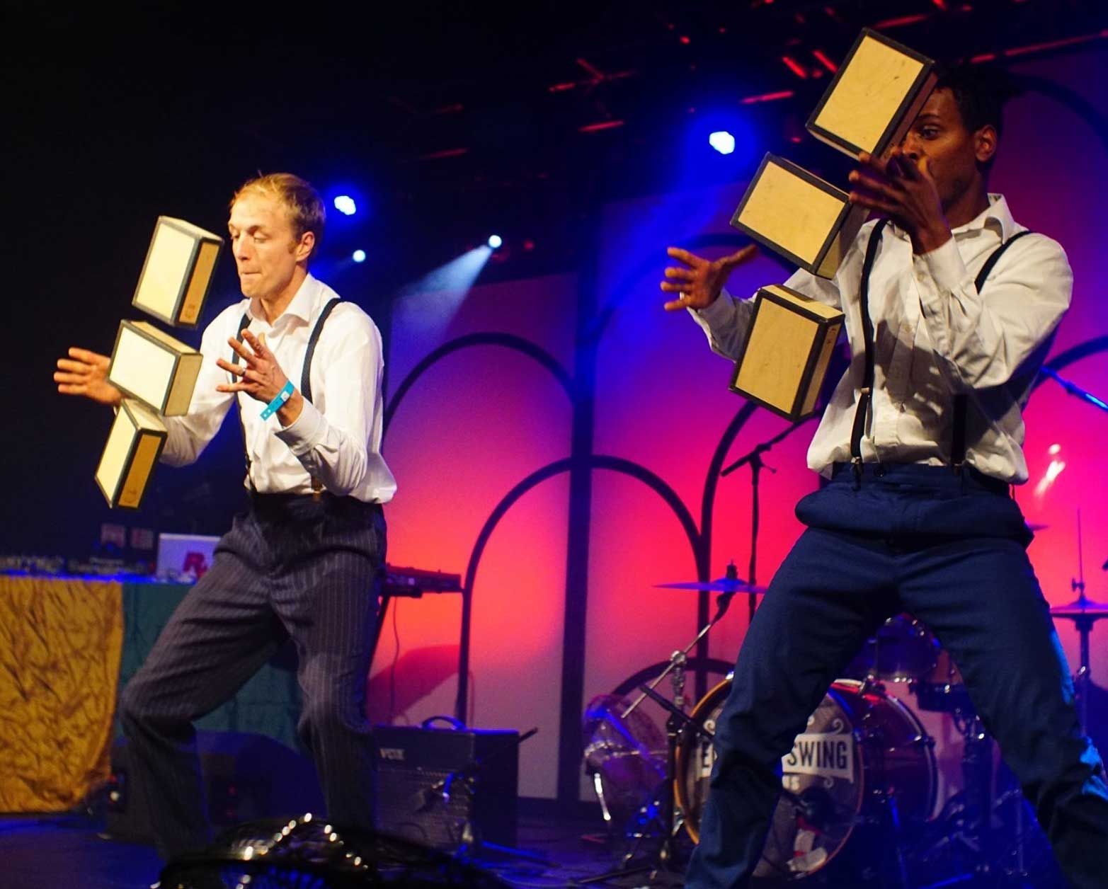 Performing a circus act with cigar boxes