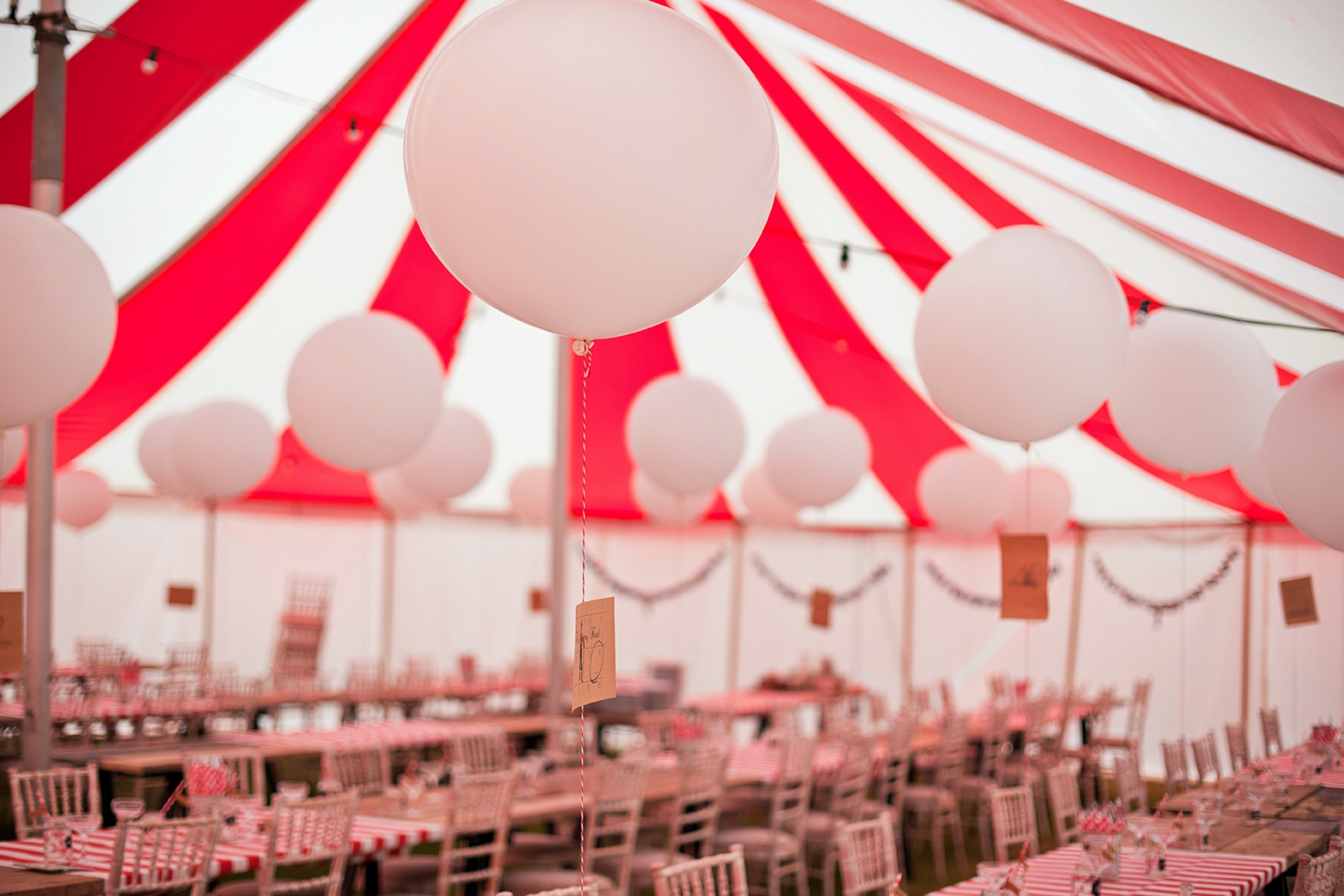 A beautiful wedding table setup inside a circus tent