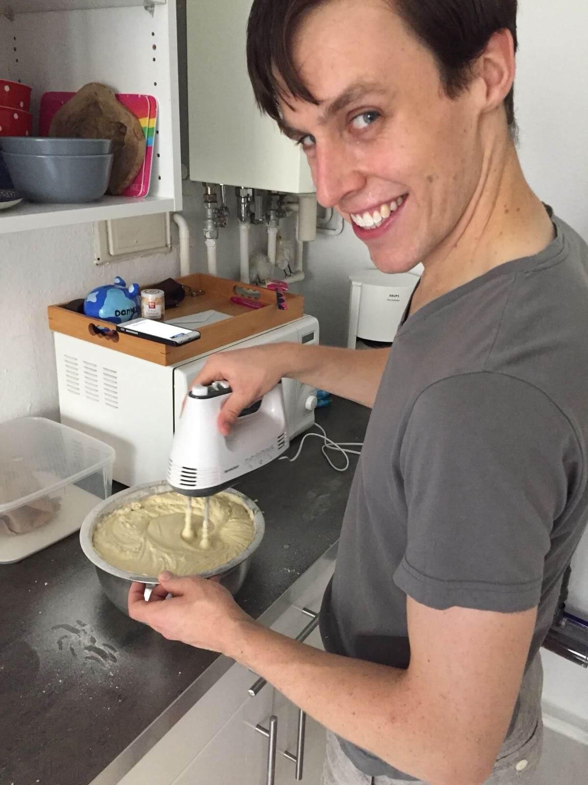 Daniel mixing a cake