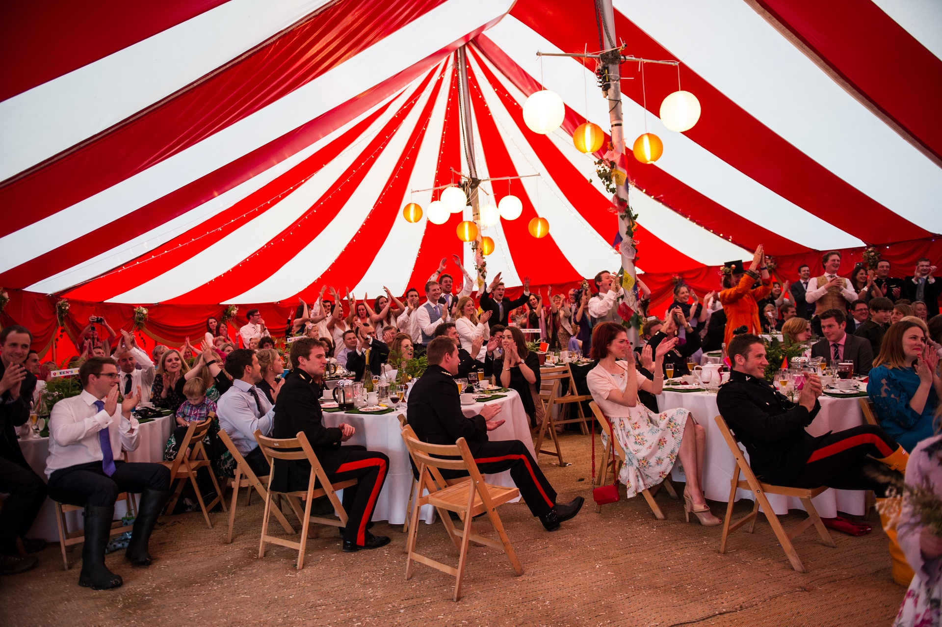 red and white circus styule marquee at festival wedding in somerset near Glastonbury and Shepton Mallet uk.