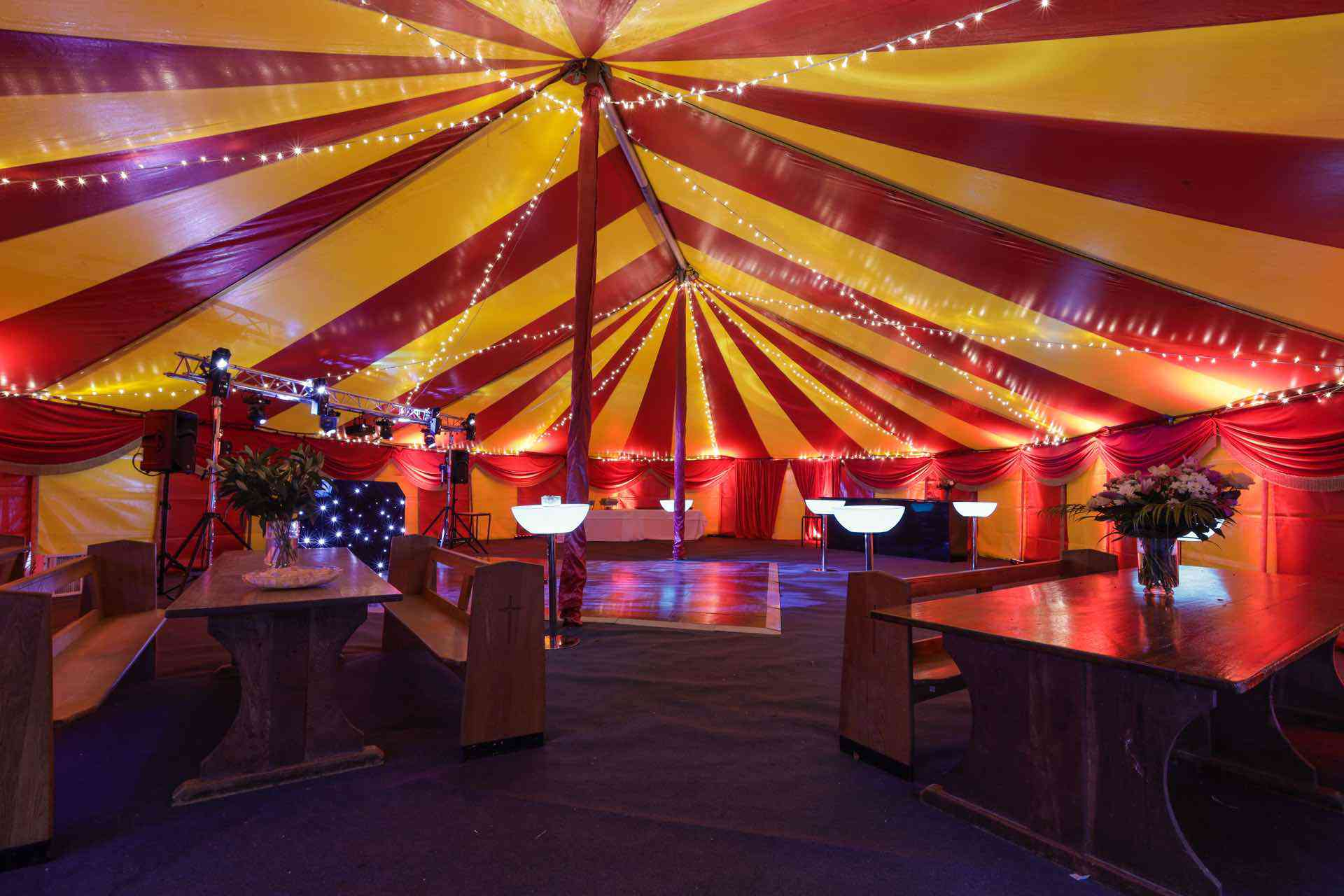 private party in red and yellow tents near brighton uk