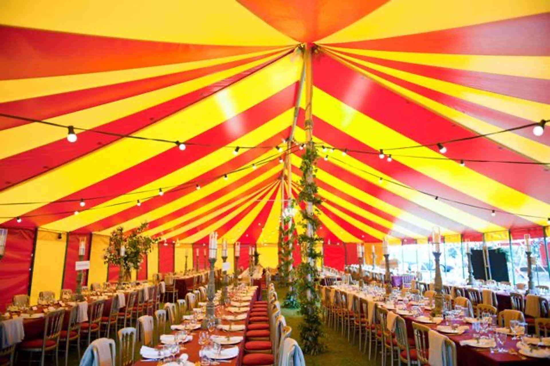 interior of stylish red and yellow circus style marquee