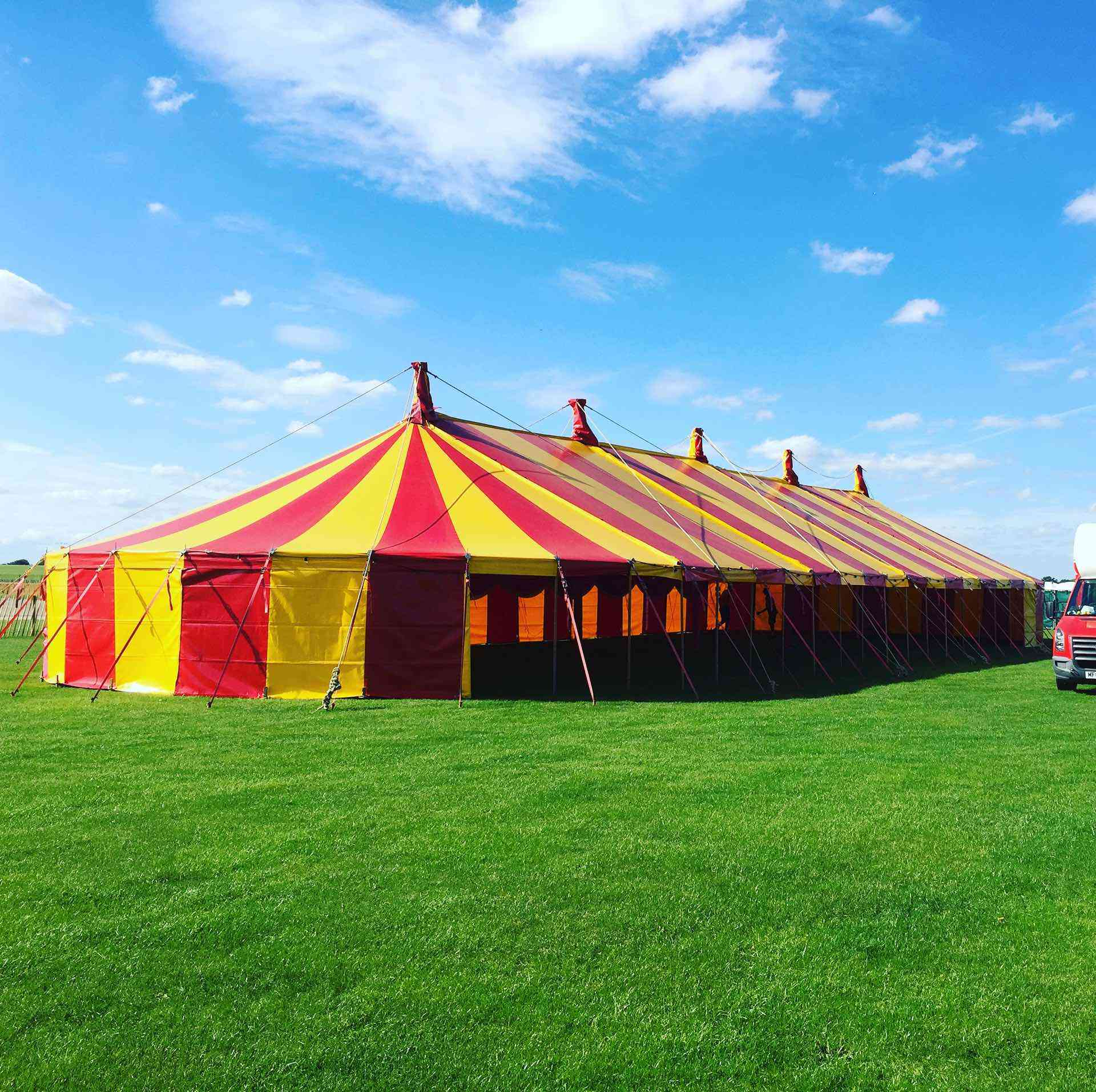 colouful large red and yellow striped marquee hire for music venue at Atomic festival in northamptonshire