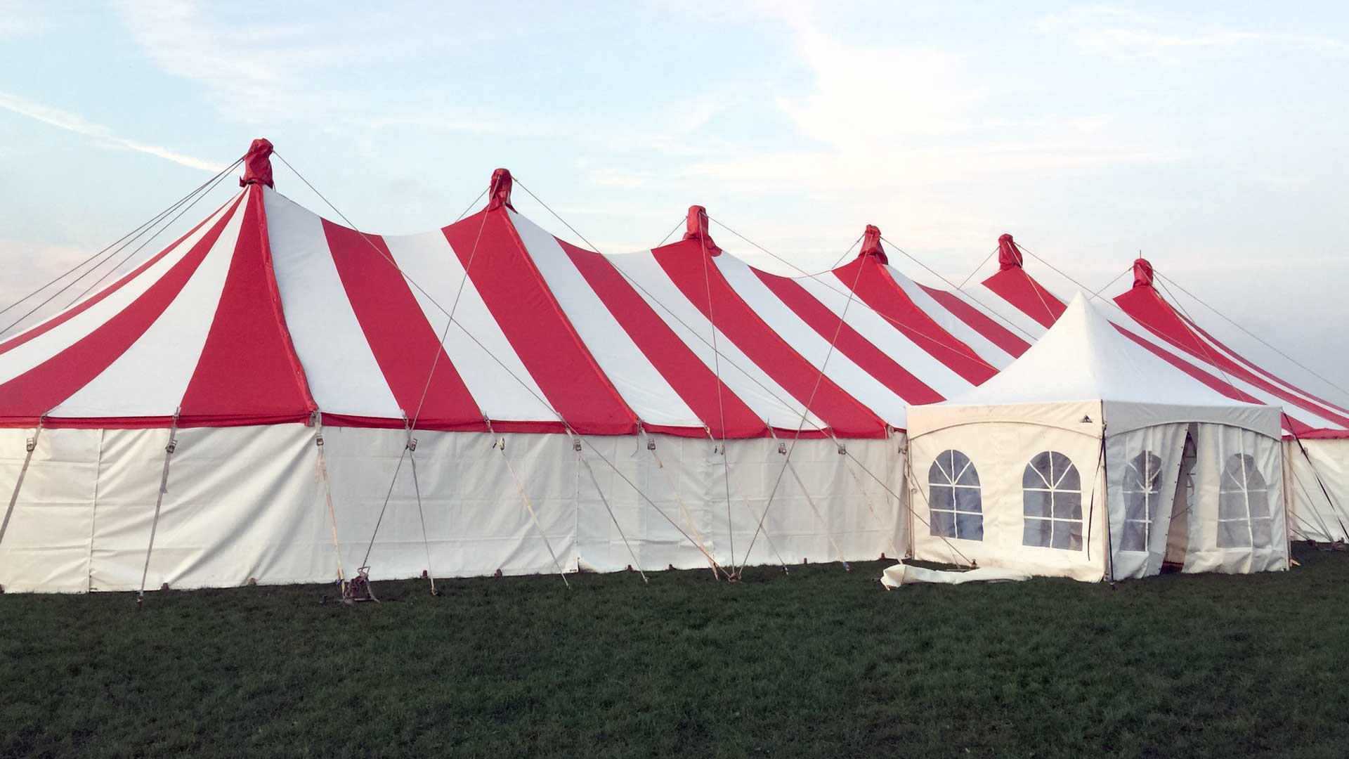 Large red & white circus tent for hire
