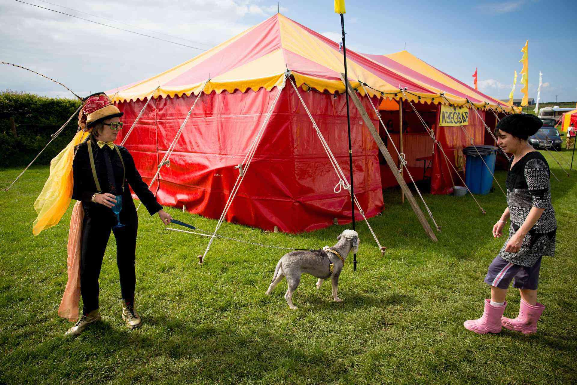 Golden garden party tent as a bar at festival wedding