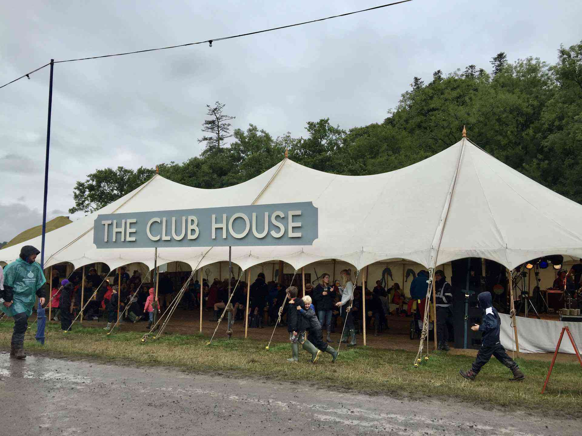 white traditional canvas pole marquee used for festival venue in Devon uk