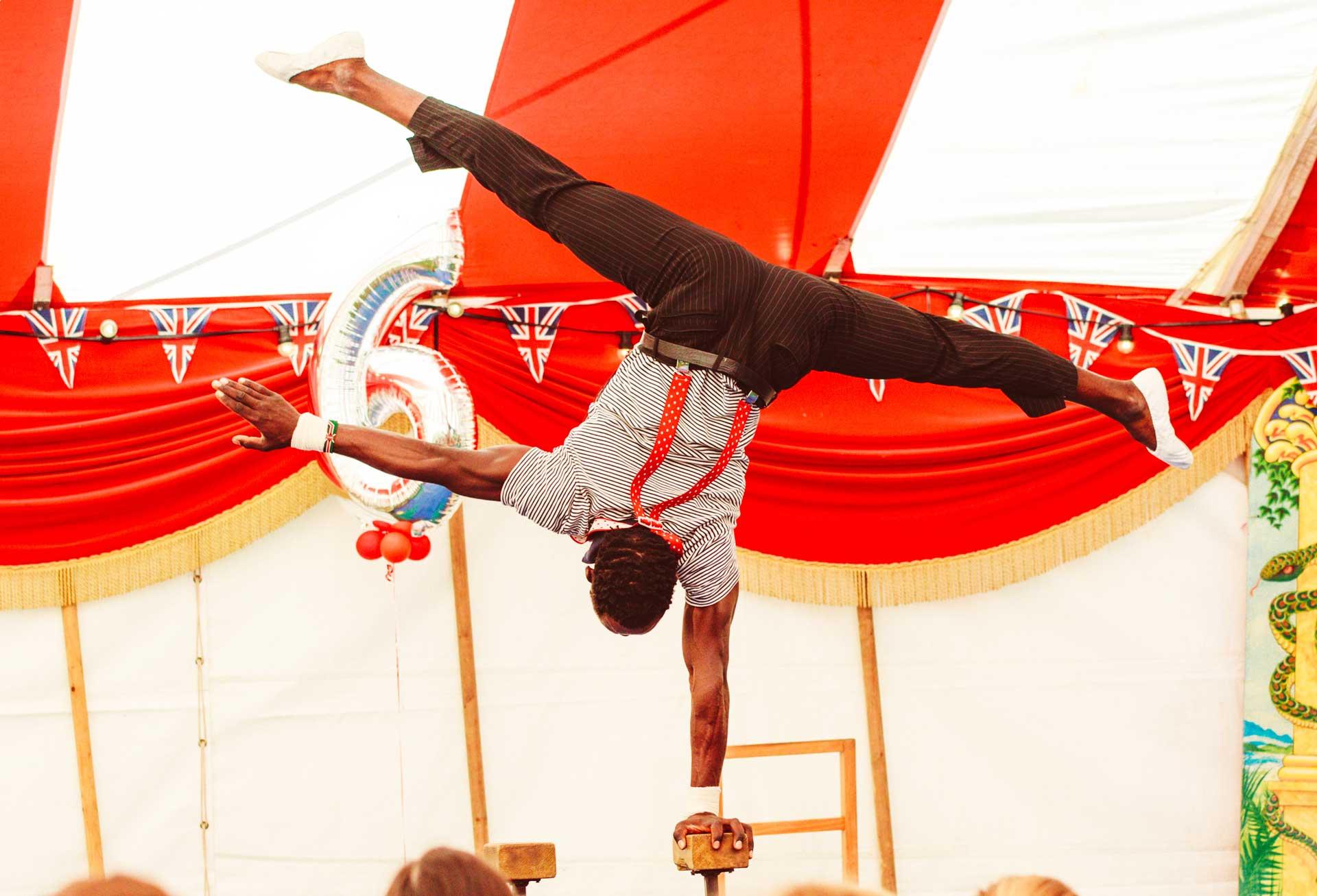 hand balancer at a big top circus party