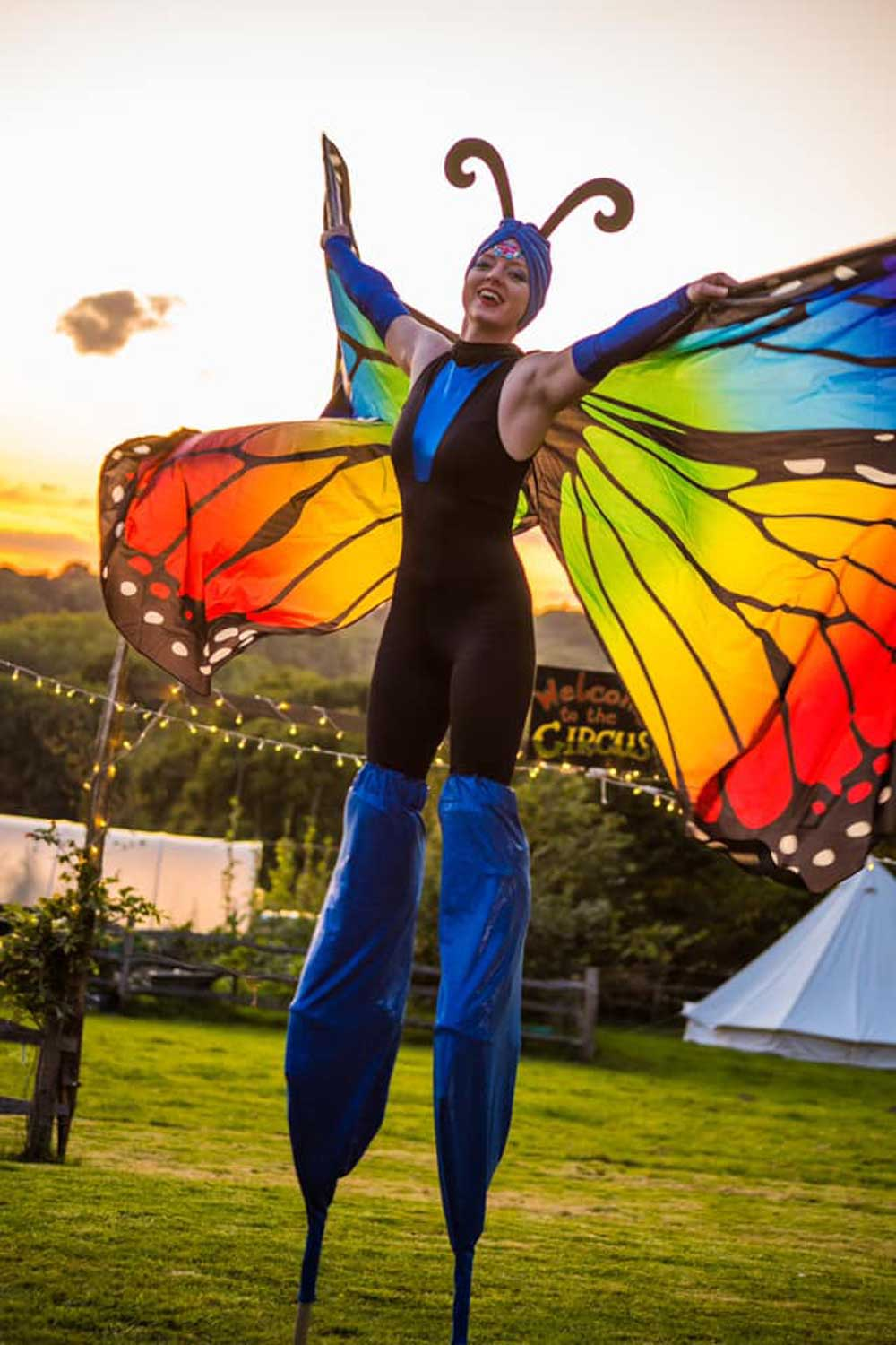 bigtopmanias butterfly costume stilt walkers at a party