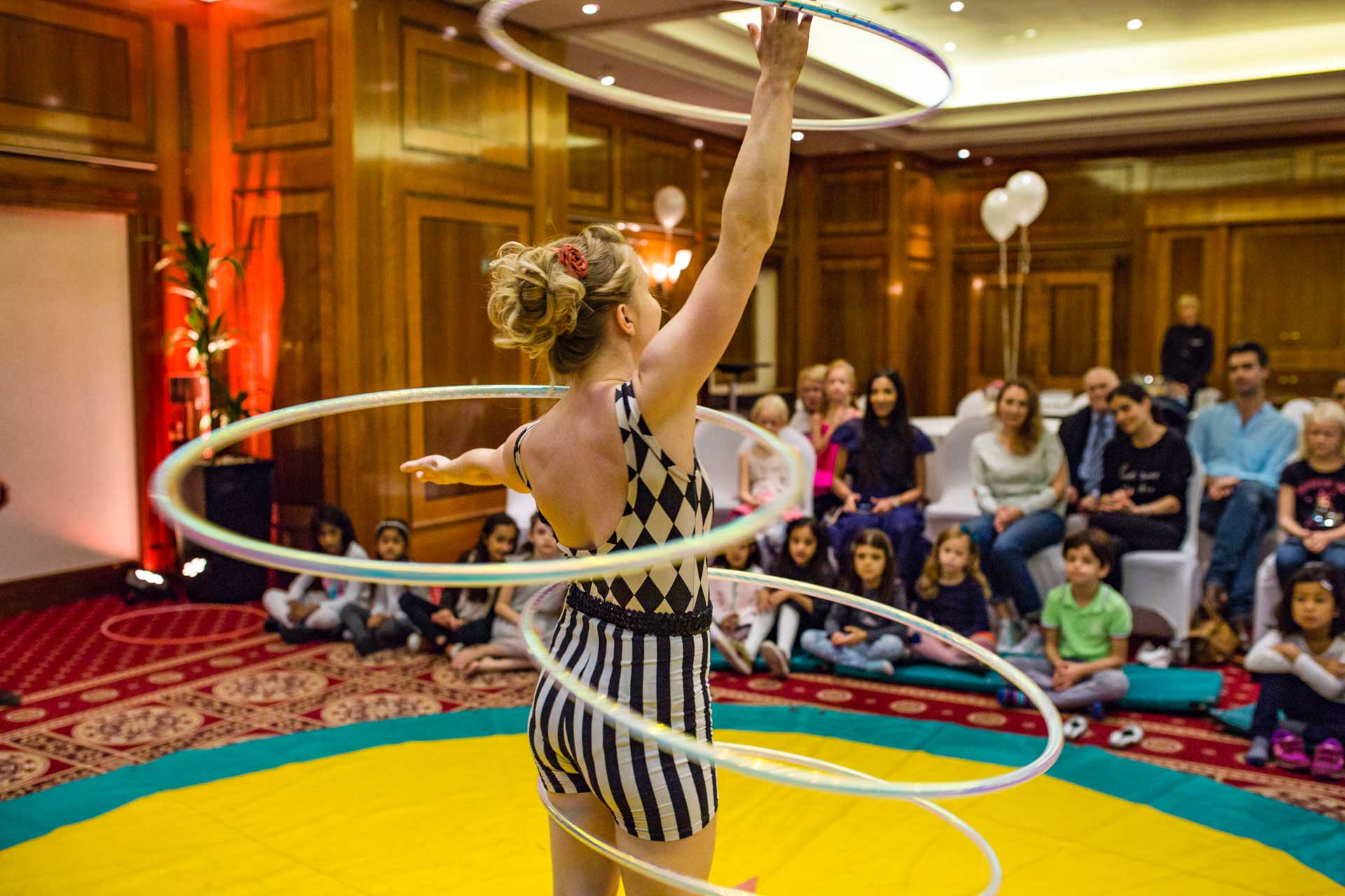 Hula hooper at a smart family circus party in london