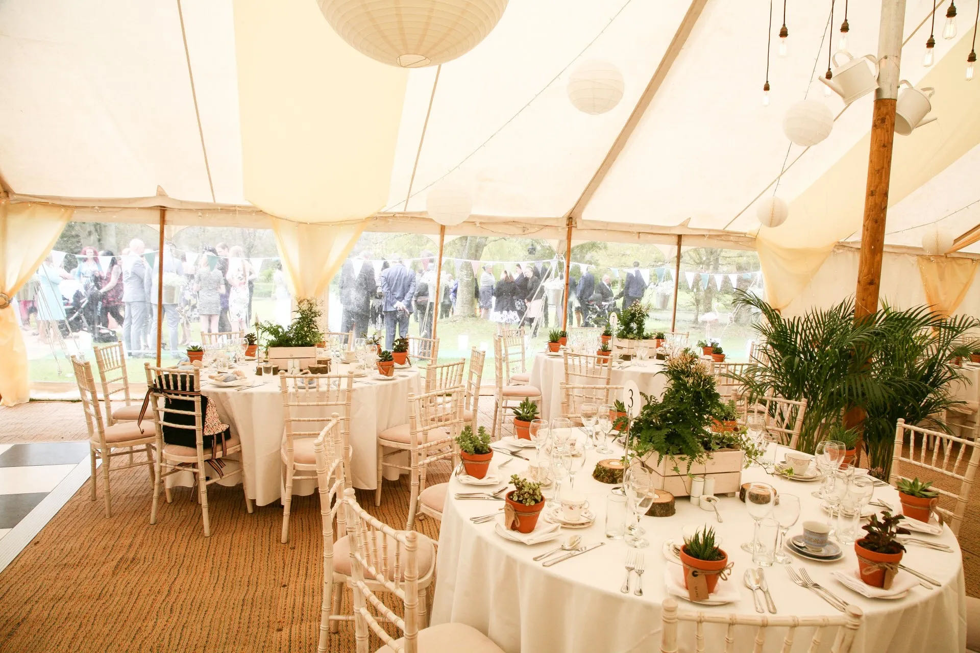 Table layout arrangements in traditional canvas marquee in Cirencester, Gloucestershire