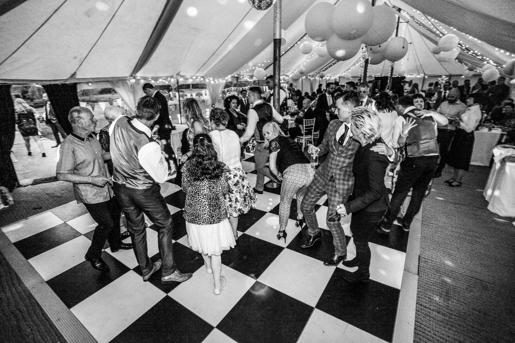 Fun on the dance floor at a same-sex marriage wedding reception