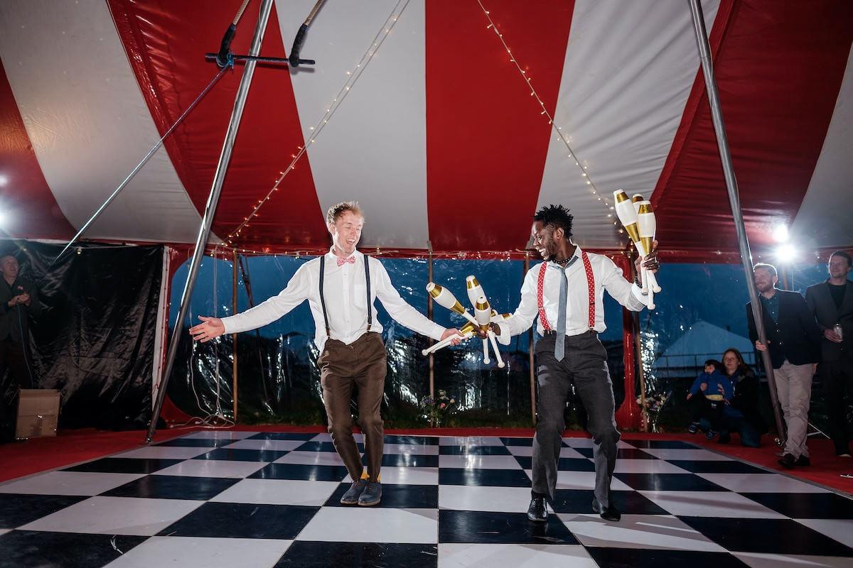 Juggling act circus show at colourful big-top wedding