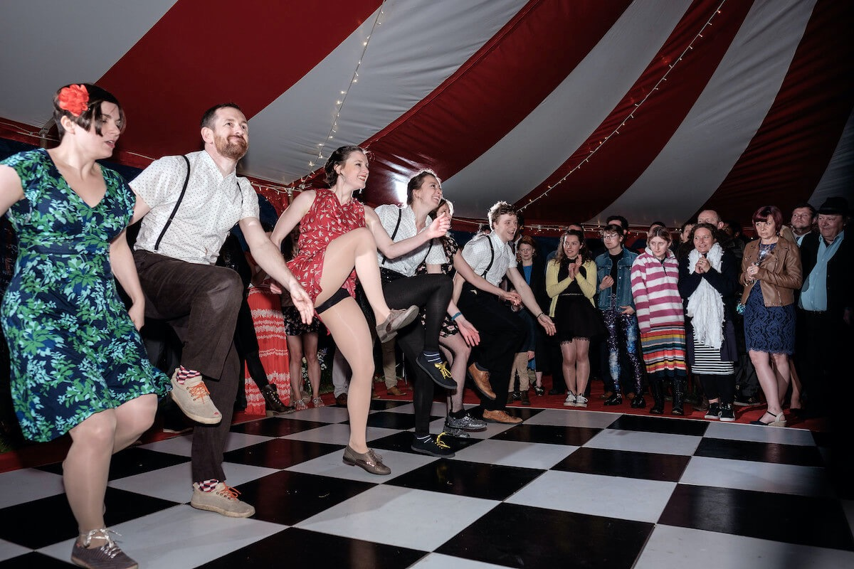 The Mud Flappers swing dance team at a festival theme wedding