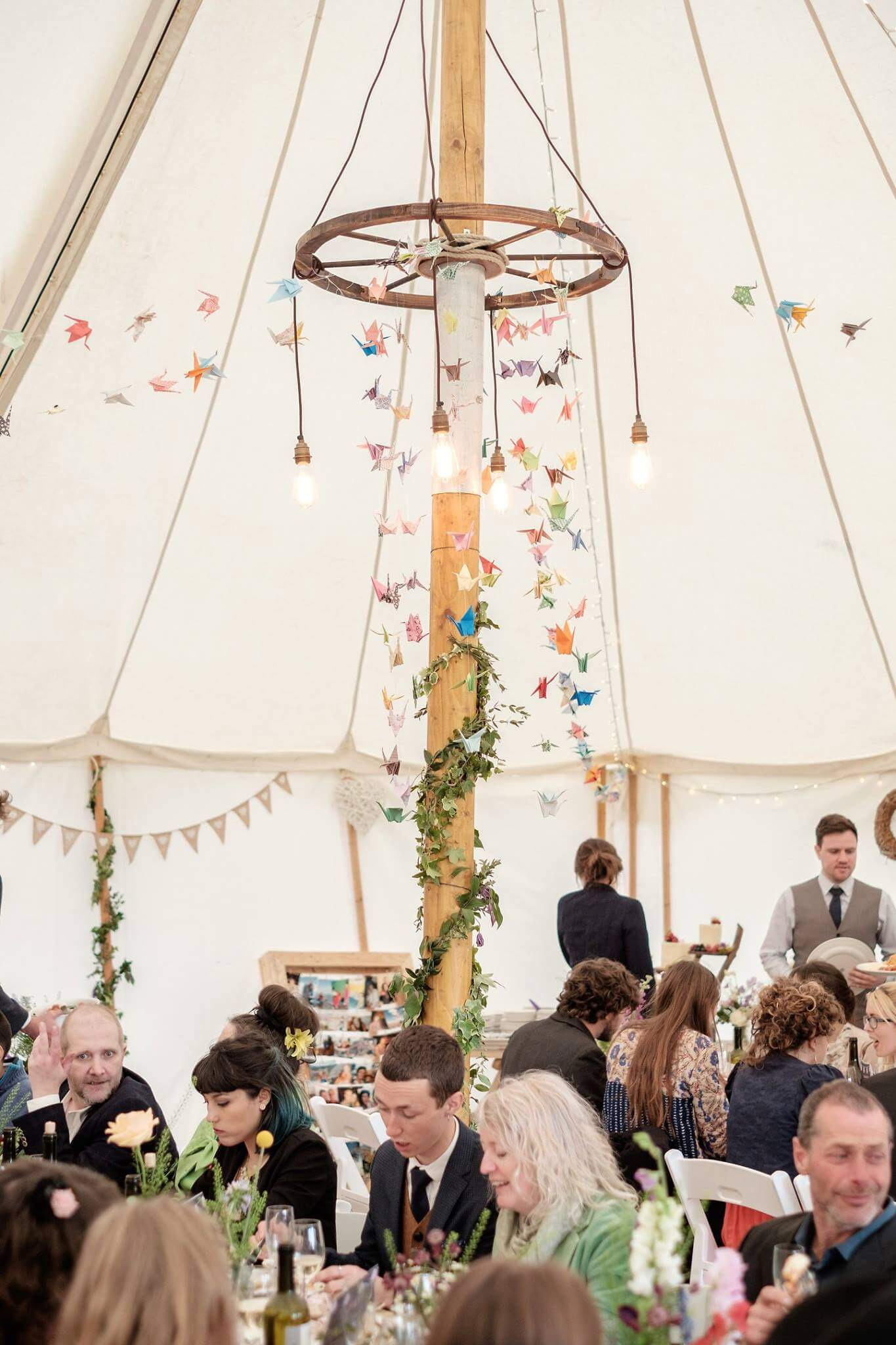 Wagon wheel chandelier and vintage dangly lighting in marquee