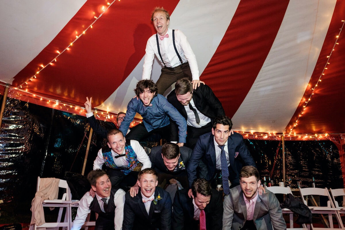 Acrobatic fun by guests at alternative circus theme wedding in Cornwall