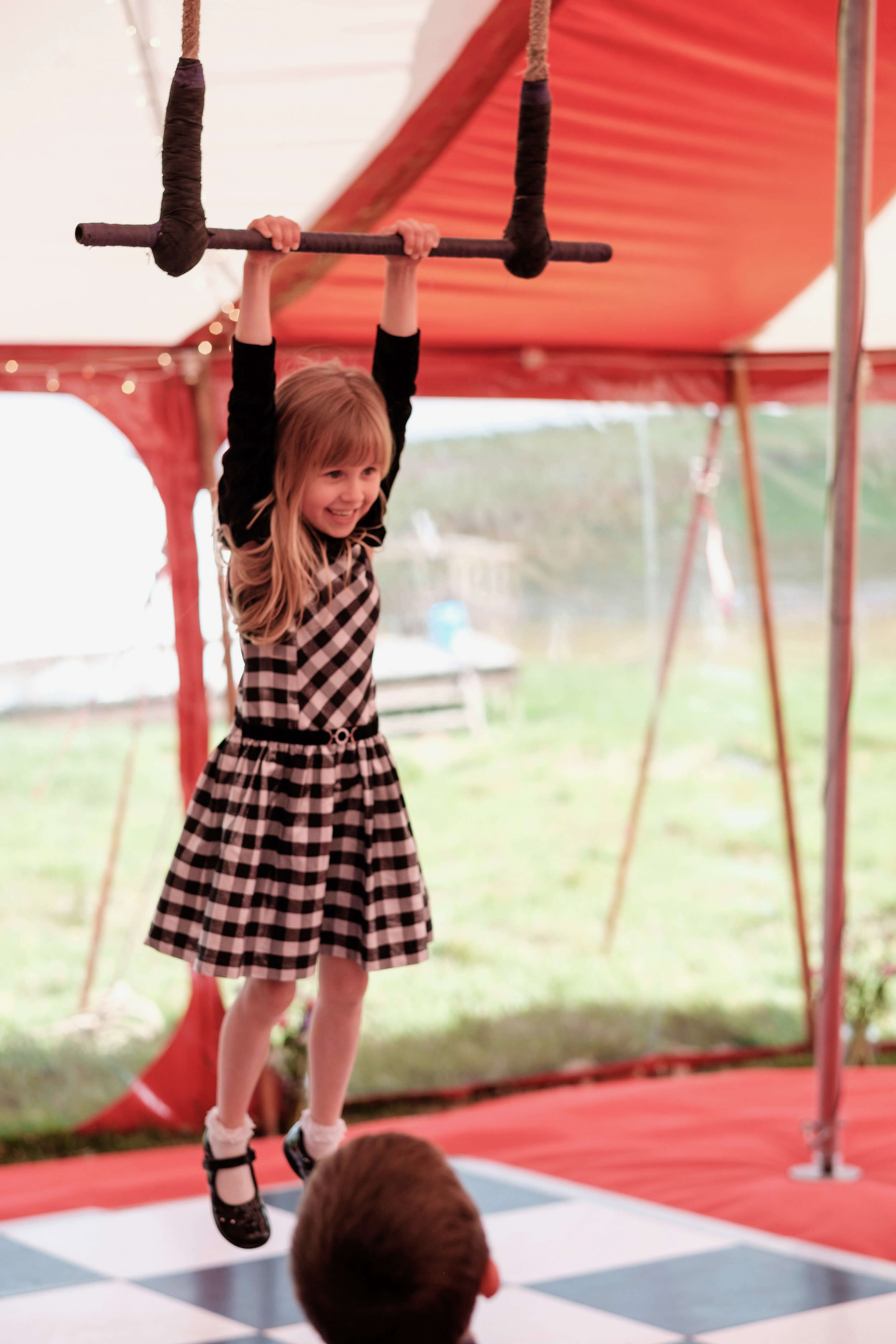 Trapeze lessons at a circus theme wedding