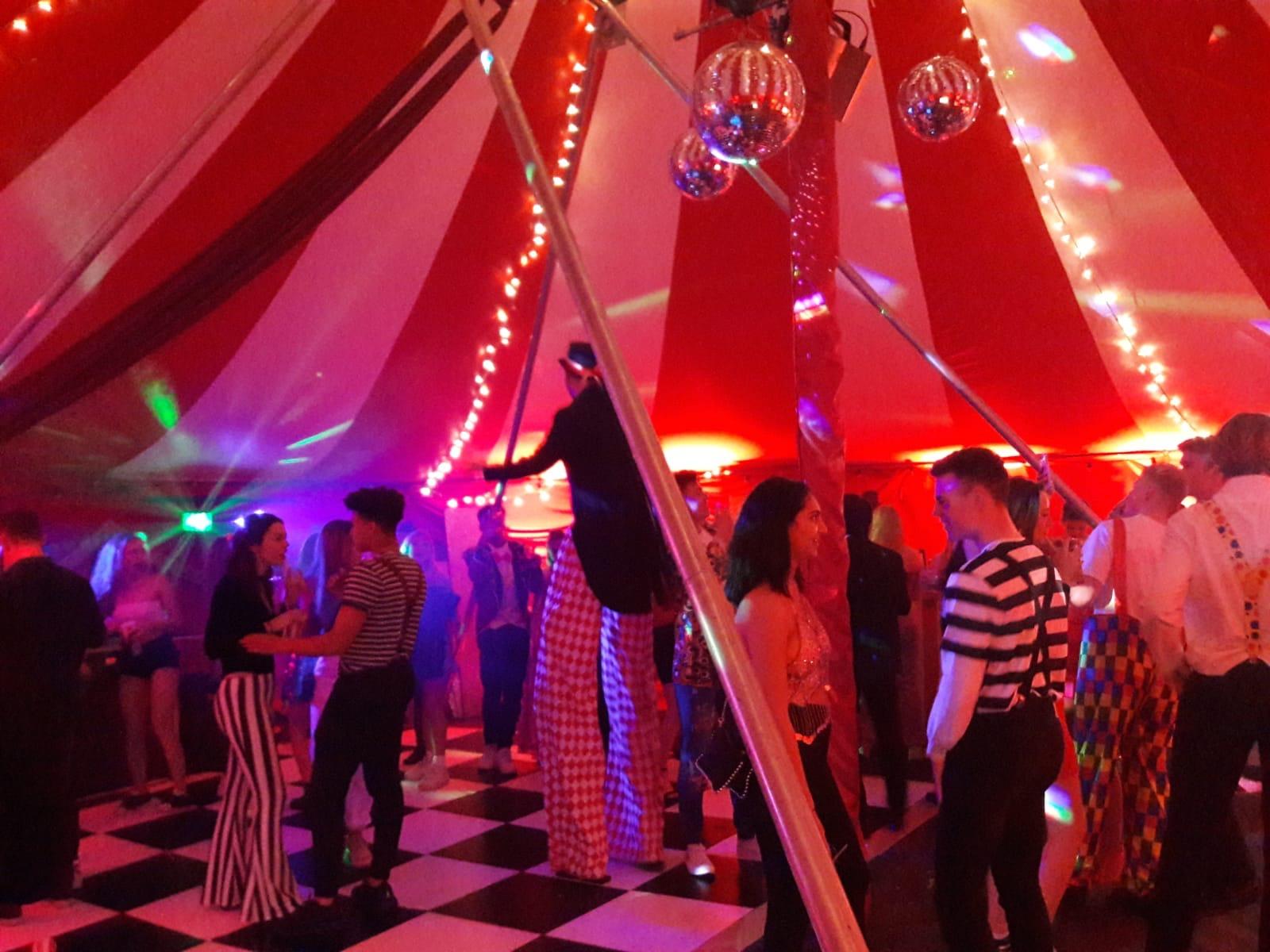Inside circus party nightclub tent