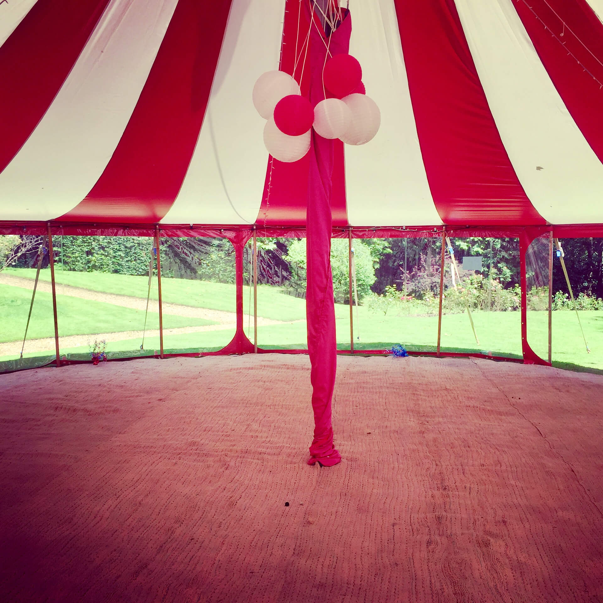 Red and white paper lanterns in Big Top