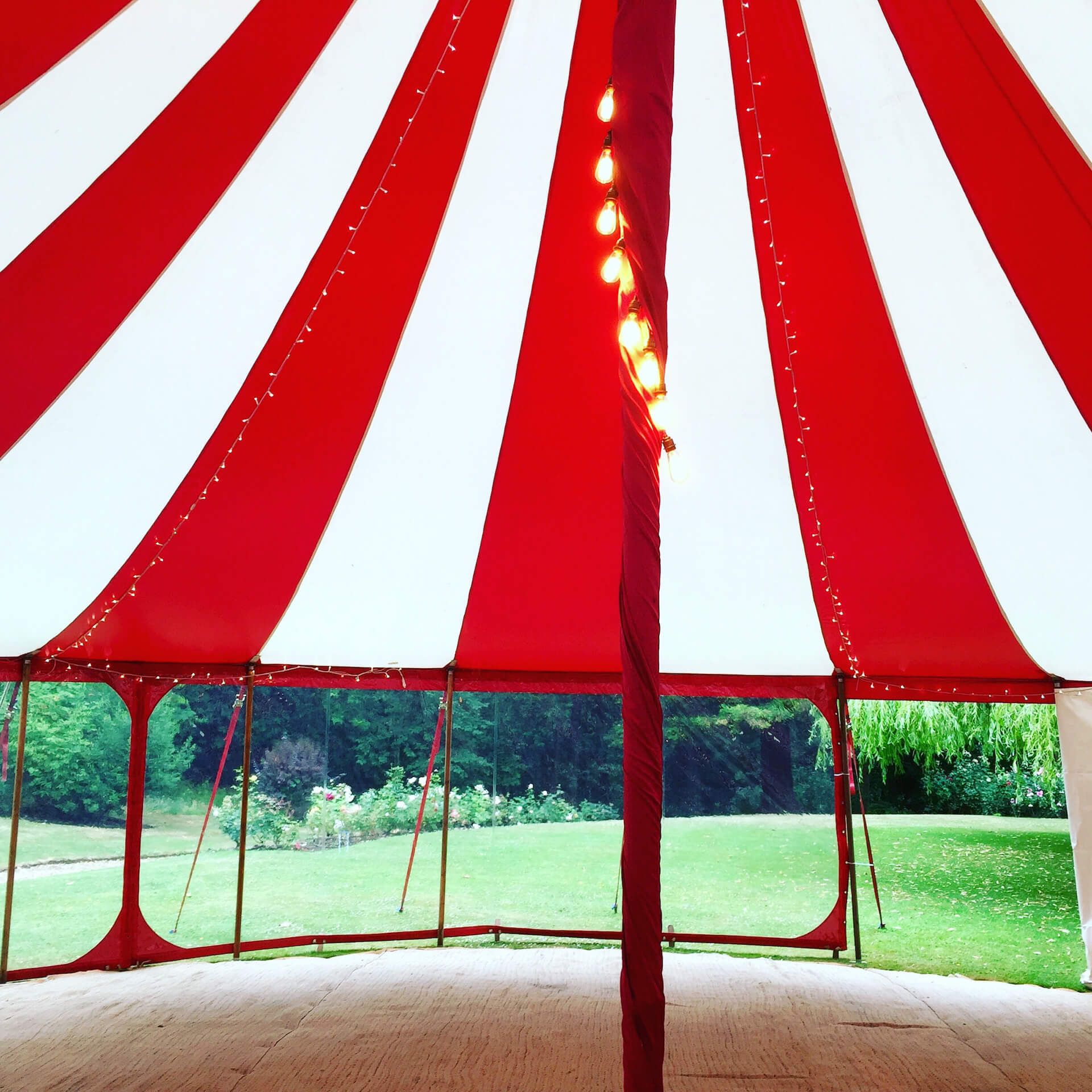 Dangly vintage lights in circus tent